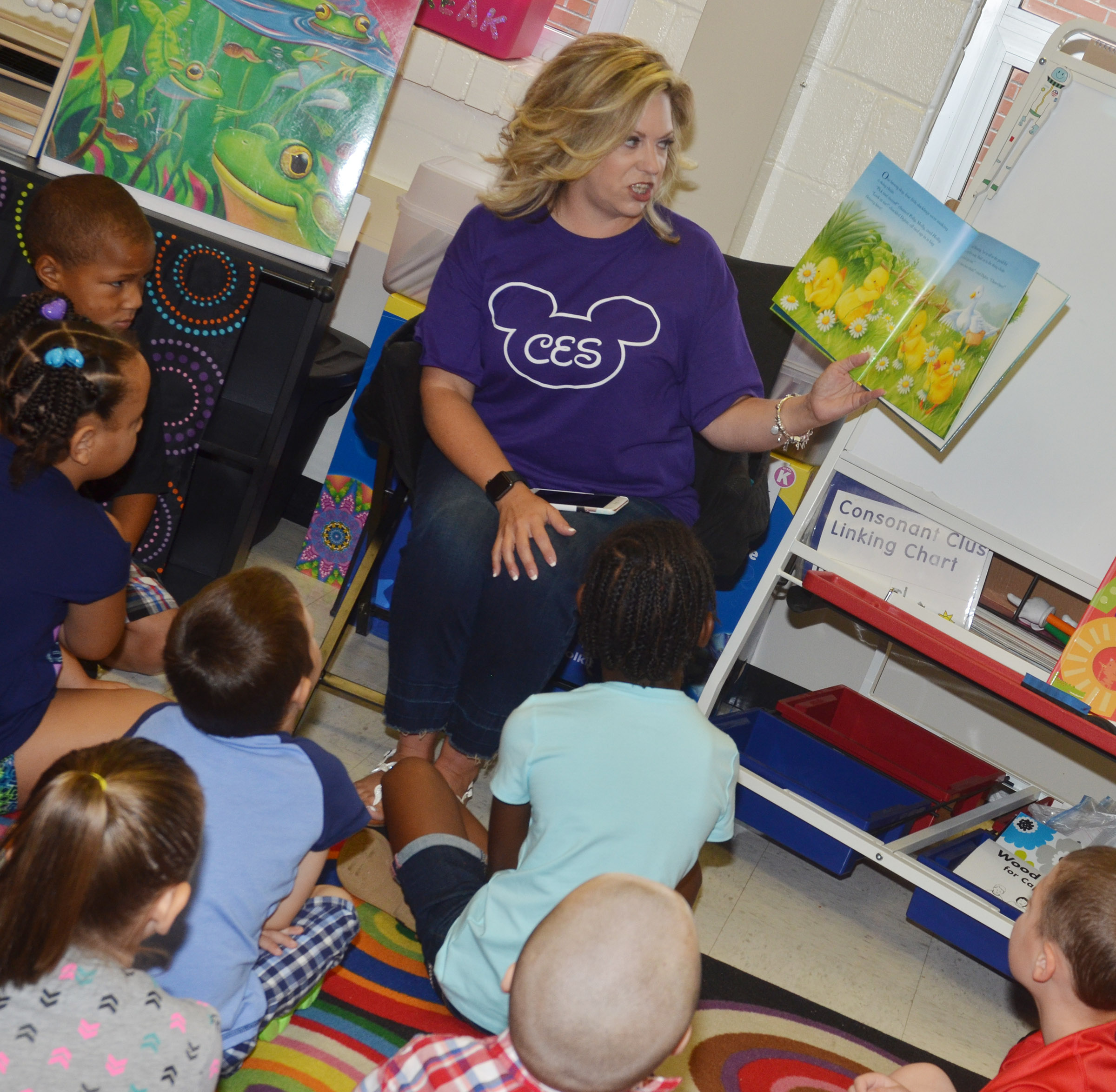 CES kindergarten teacher Nikki Price reads to her students.