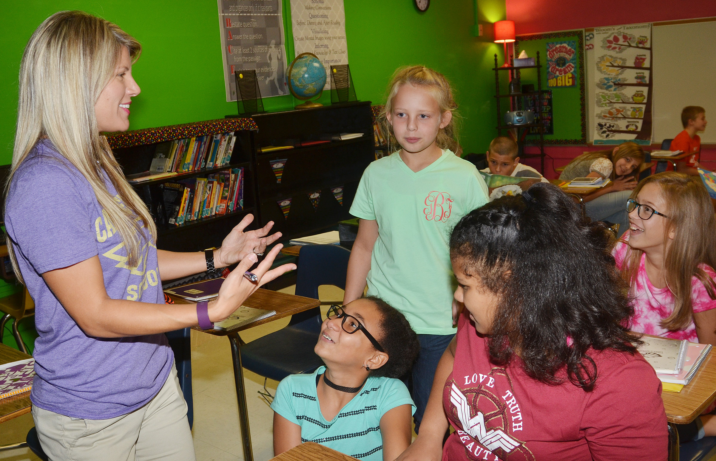 CMS sixth-grade teacher Andrea Gribbins talks with students, from left, Keely Thompson, Gabrielle Bright, Kehleigh Vaught and Chloe Thompson.