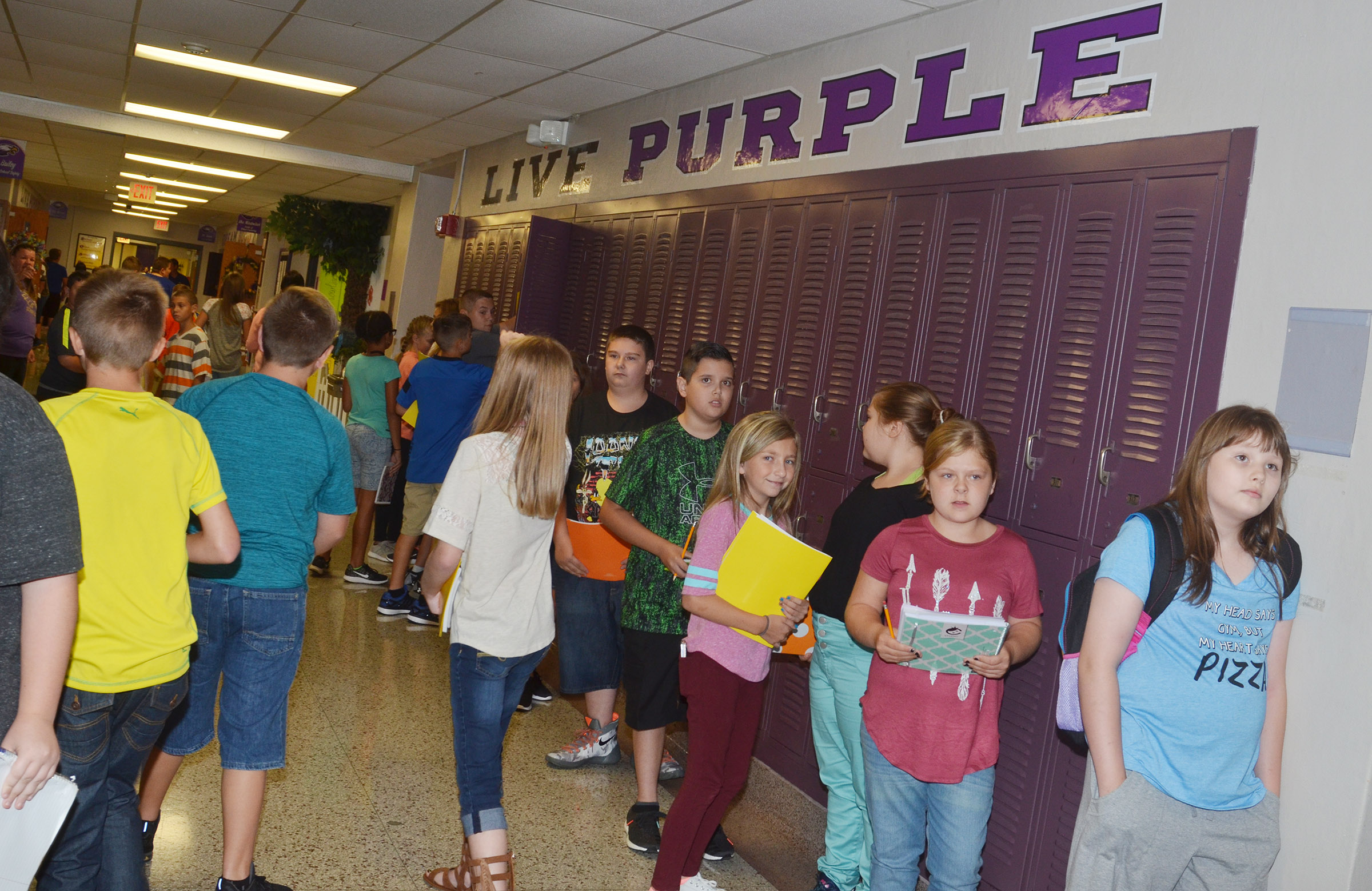 CMS students walk to their classrooms.