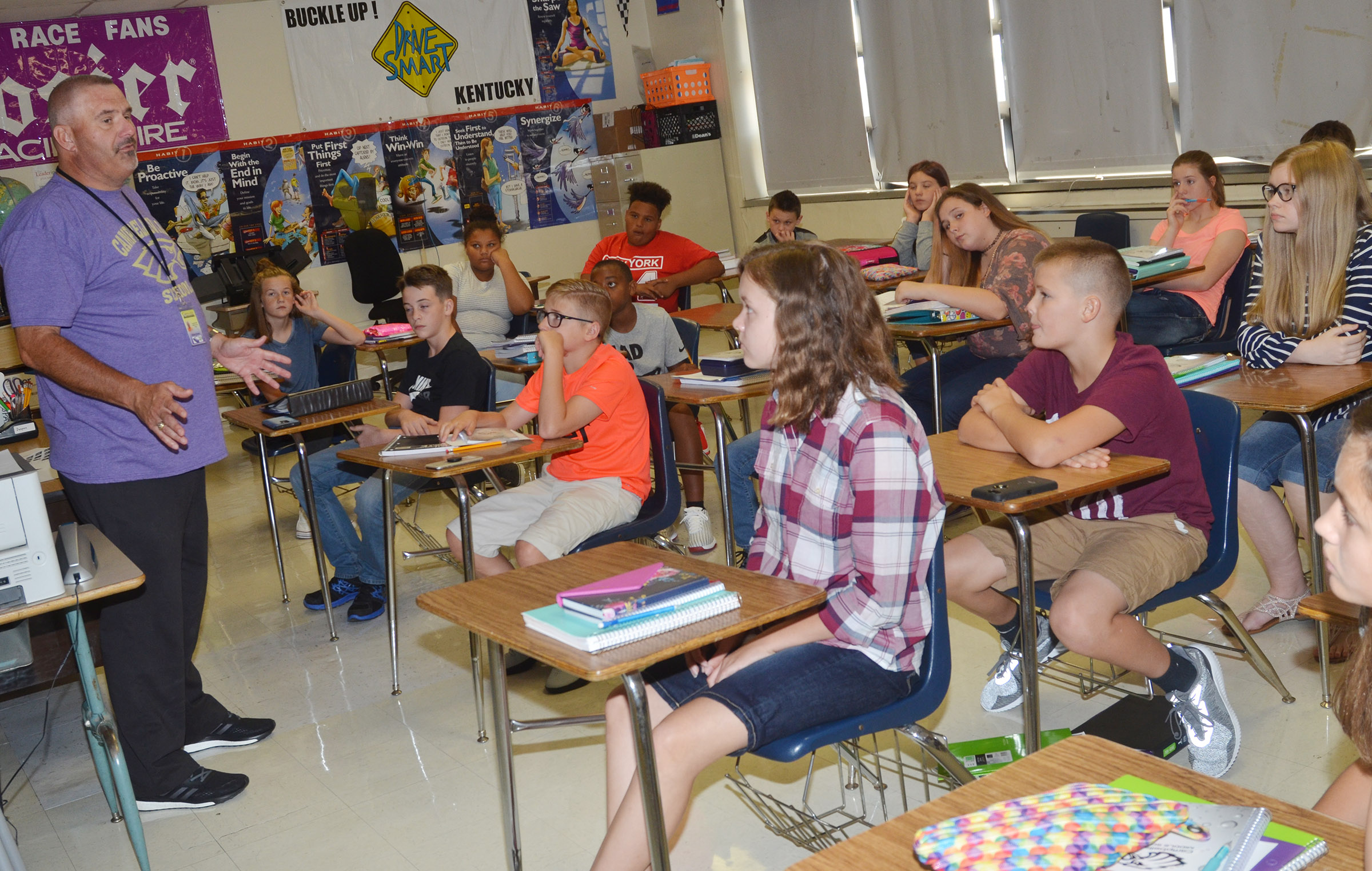 CMS seventh-grade teacher Michael Despain tells his students what he expects of them this school year.