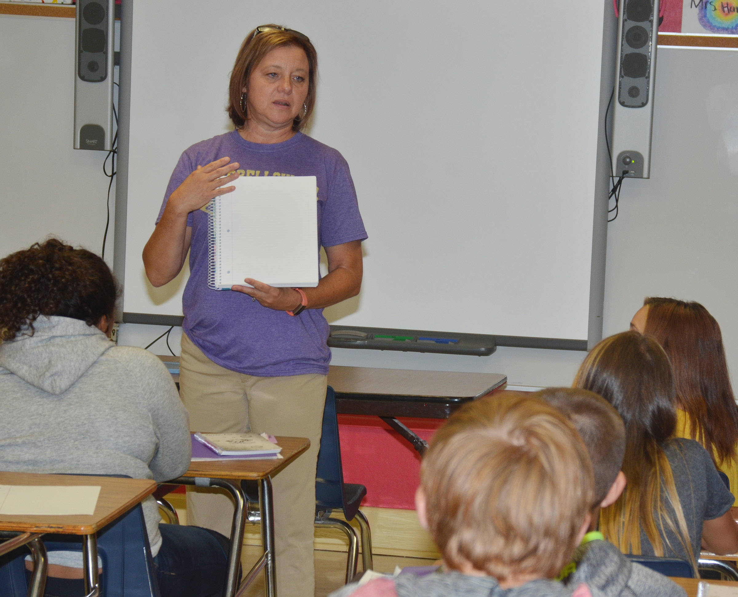 CMS seventh-grade teacher Sharon Harris talks to her students about their homework this school year.