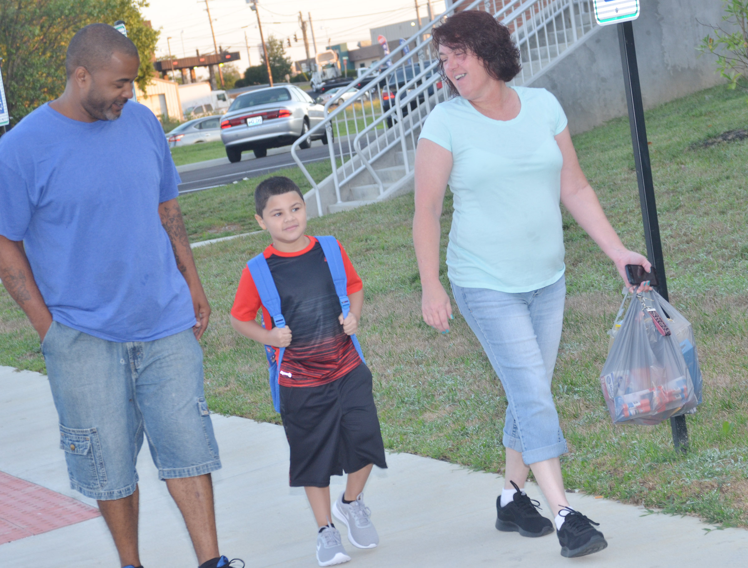 CES first-grader NyJah Vaught walks into school with his parents.