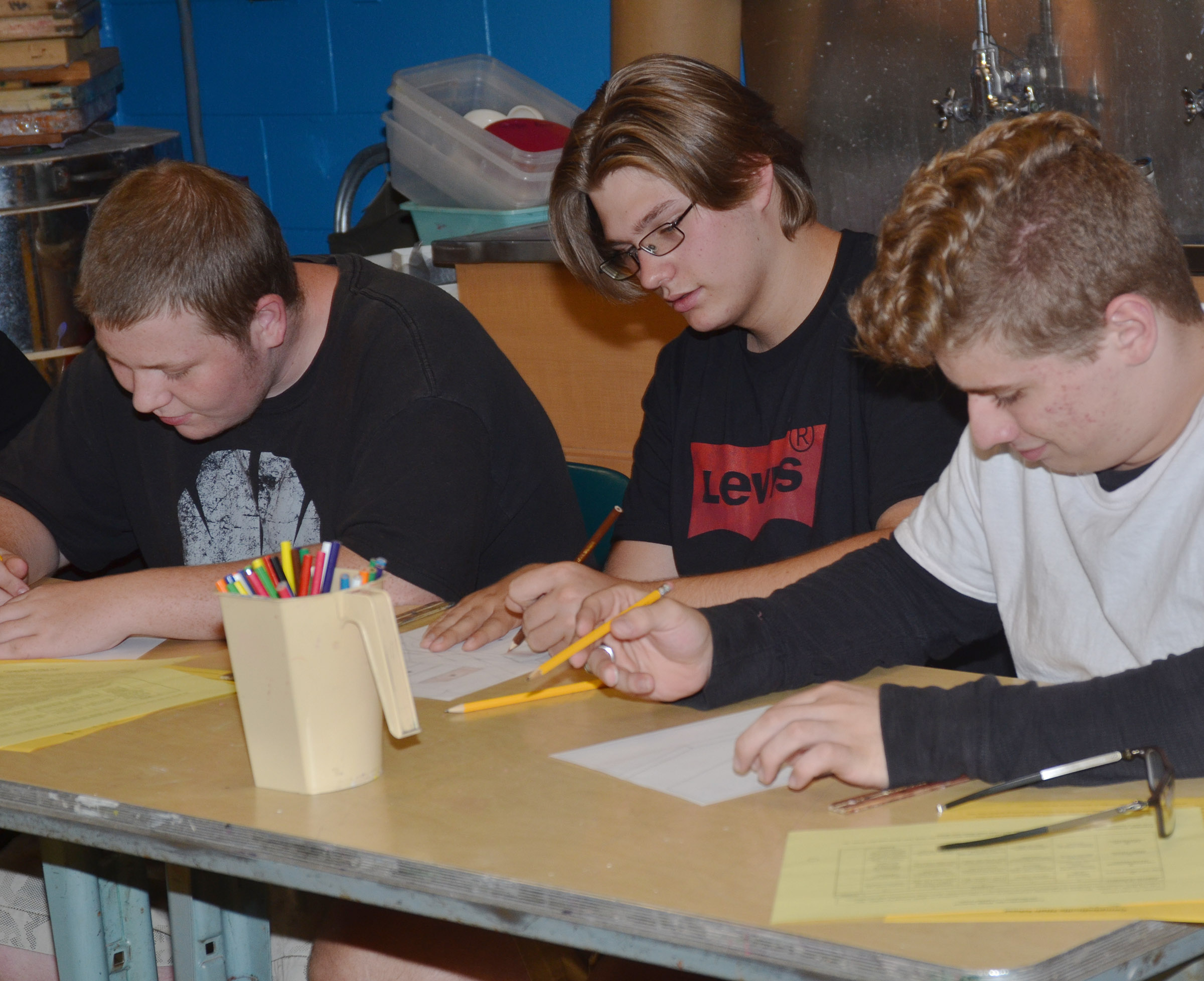 From left, CHS juniors Devin Pike, Keidlan Boils and Nicholas Lefever draw in their art class.