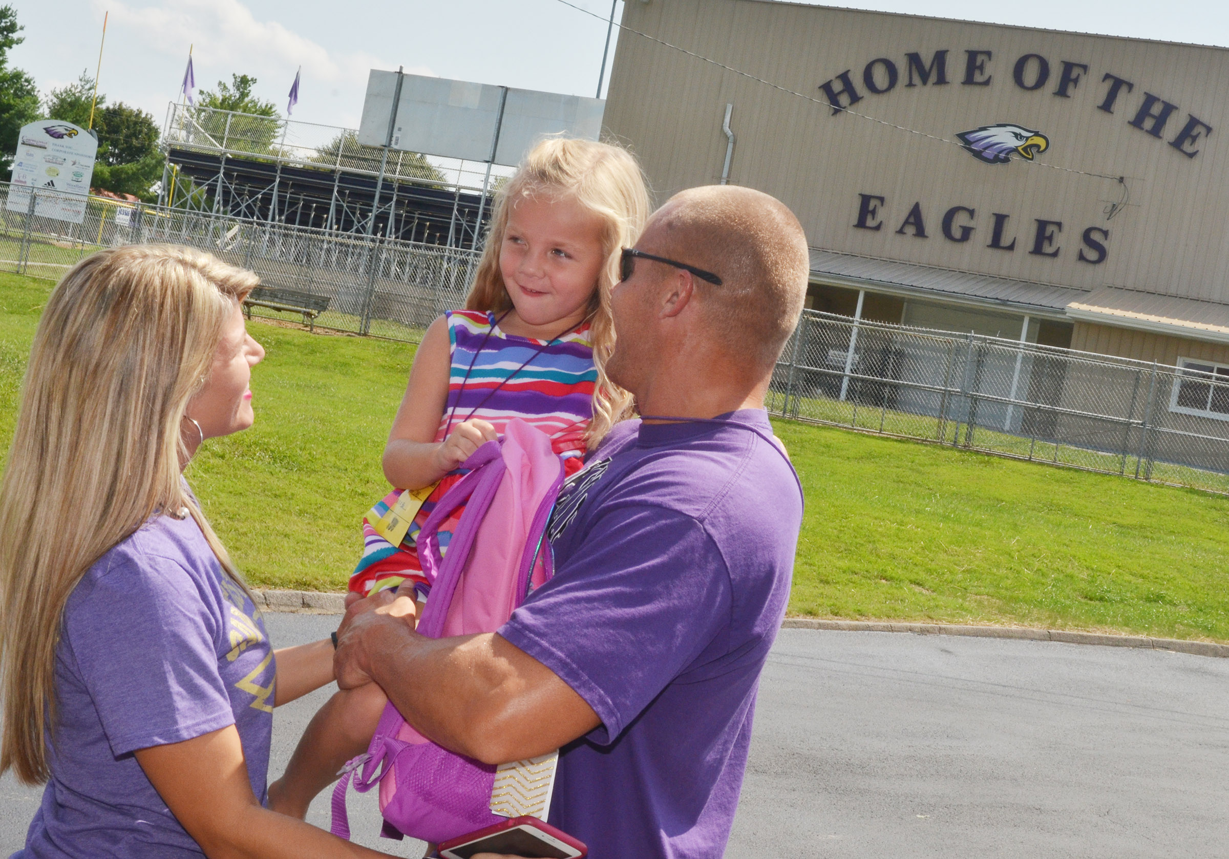 CES kindergartener Trinidy Gribbins talks to parents Andrea and Robbie after her first day of school. Andrea Gribbins is a teacher at CMS.
