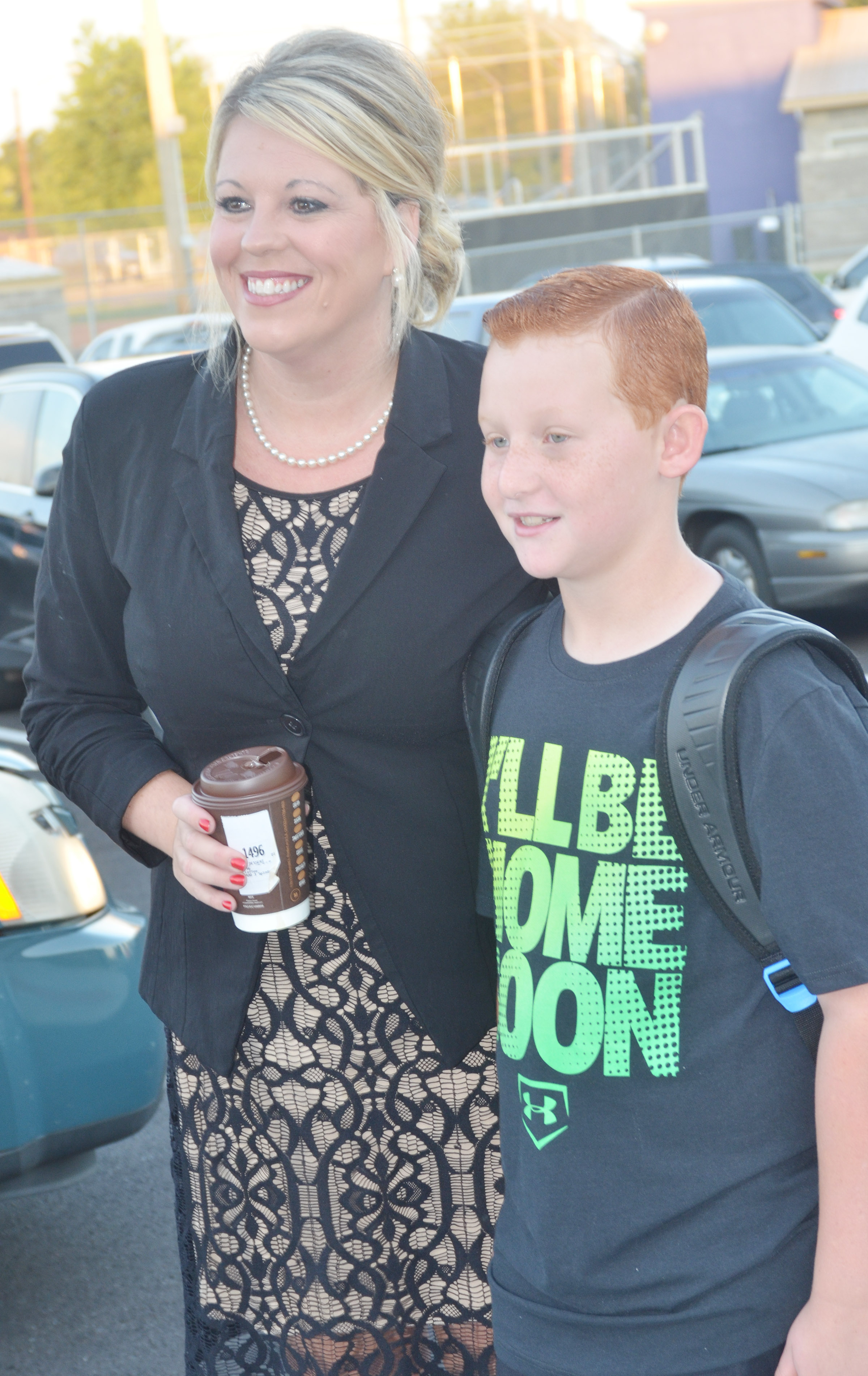 CES Principal Elisha Rhodes takes a photo with third-grader Reece Swafford.