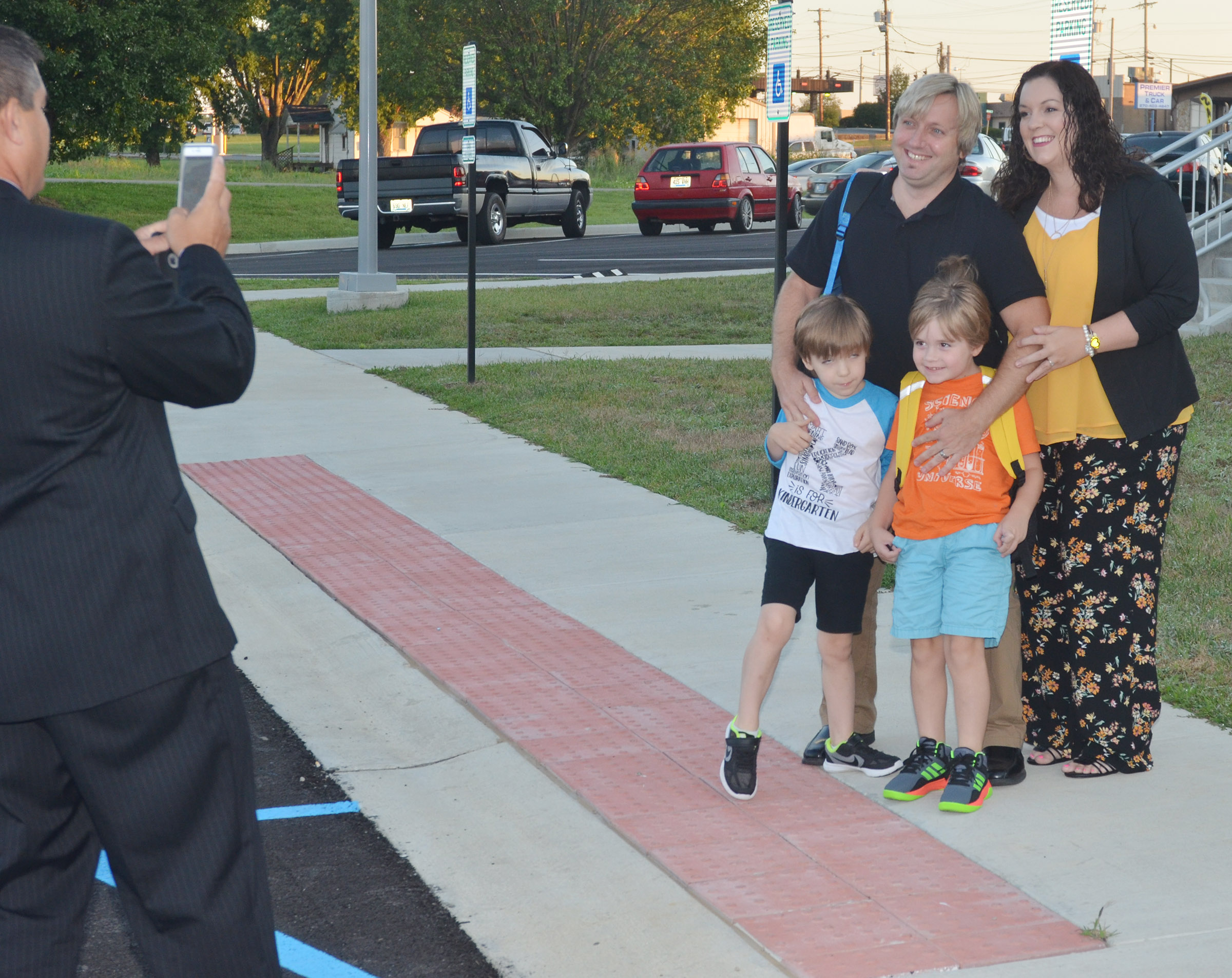 CIS Superintendent Kirby Smith takes a photo of David and Lindsay Williams with their children, kindergartener Finley Williams, at left, and first-grader Gavin Williams. David Williams is an instructional assistant at Campbellsville High School and Lindsay Williams teaches English at CHS.