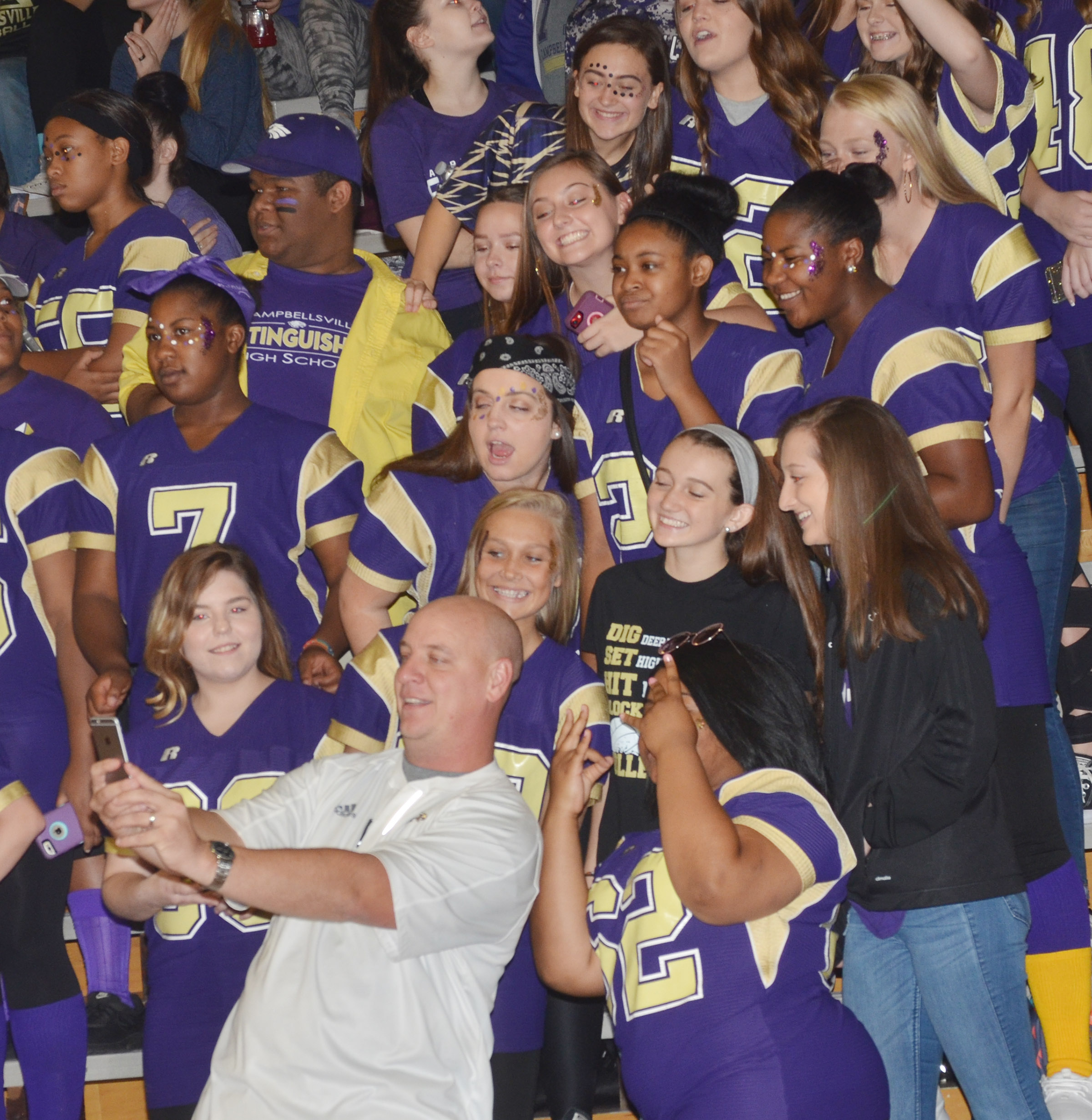 CHS Principal David Petett takes a selfie with his students.