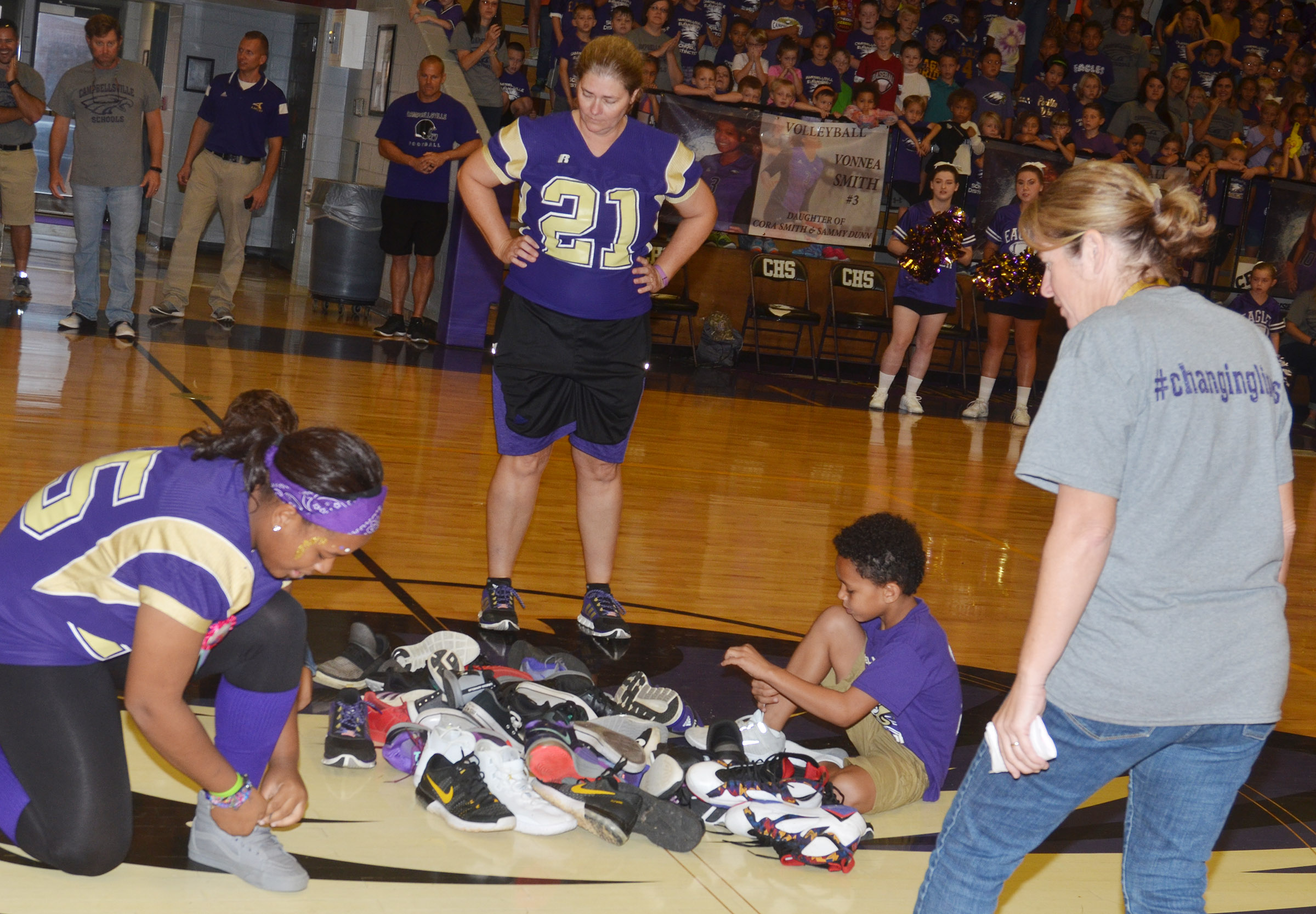 CHS senior Kayla Young, at left, and CES fourth-grader Anthony Goins compete in the shoe mountain game.
