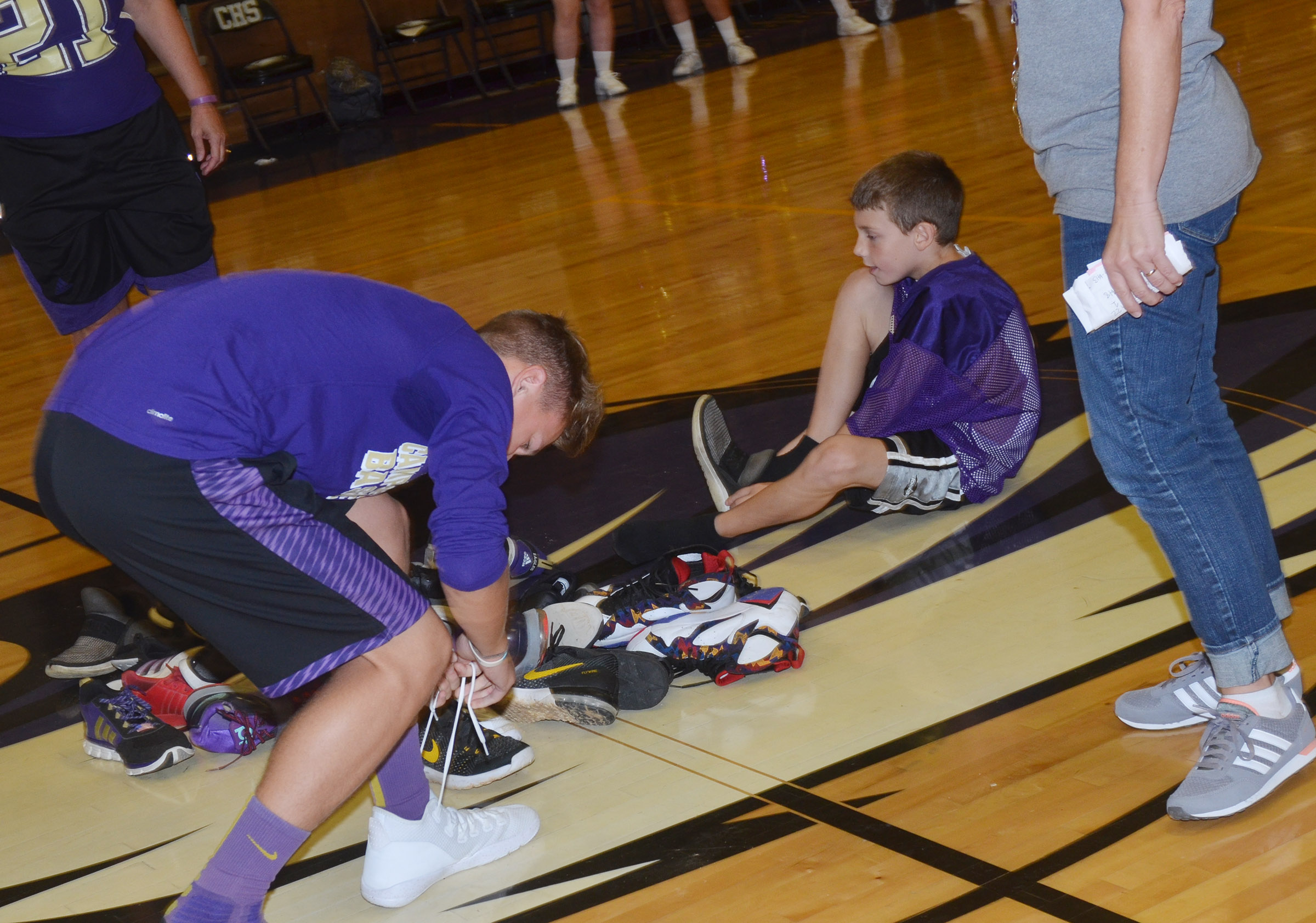 CHS freshman Blase Wheatley, at left, and CES third-grader Aidan Wilson compete in the shoe mountain game.