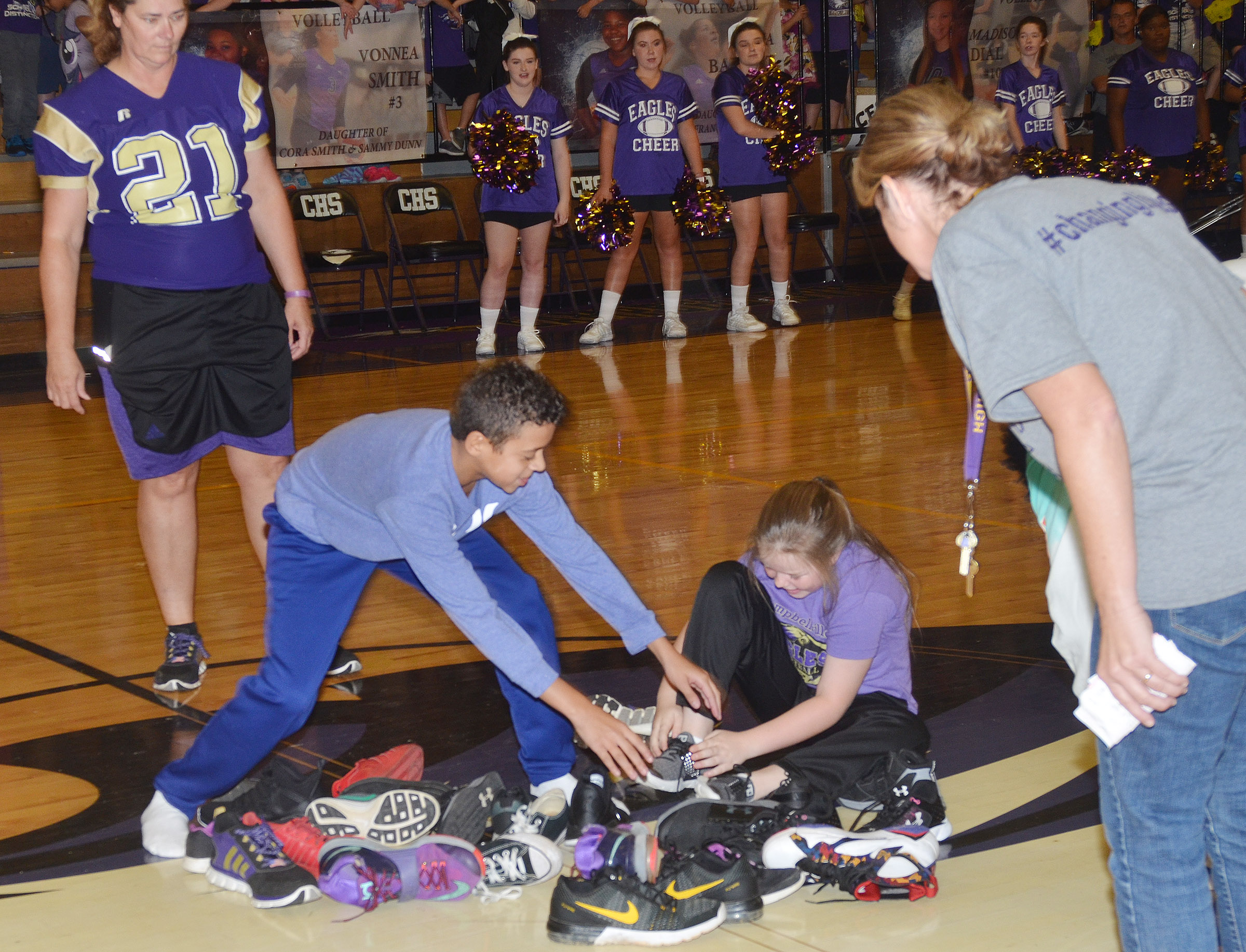 CMS sixth-grader Tucker Cartwright, at left, and CES fifth-grader Miley Hash compete in the shoe mountain game.