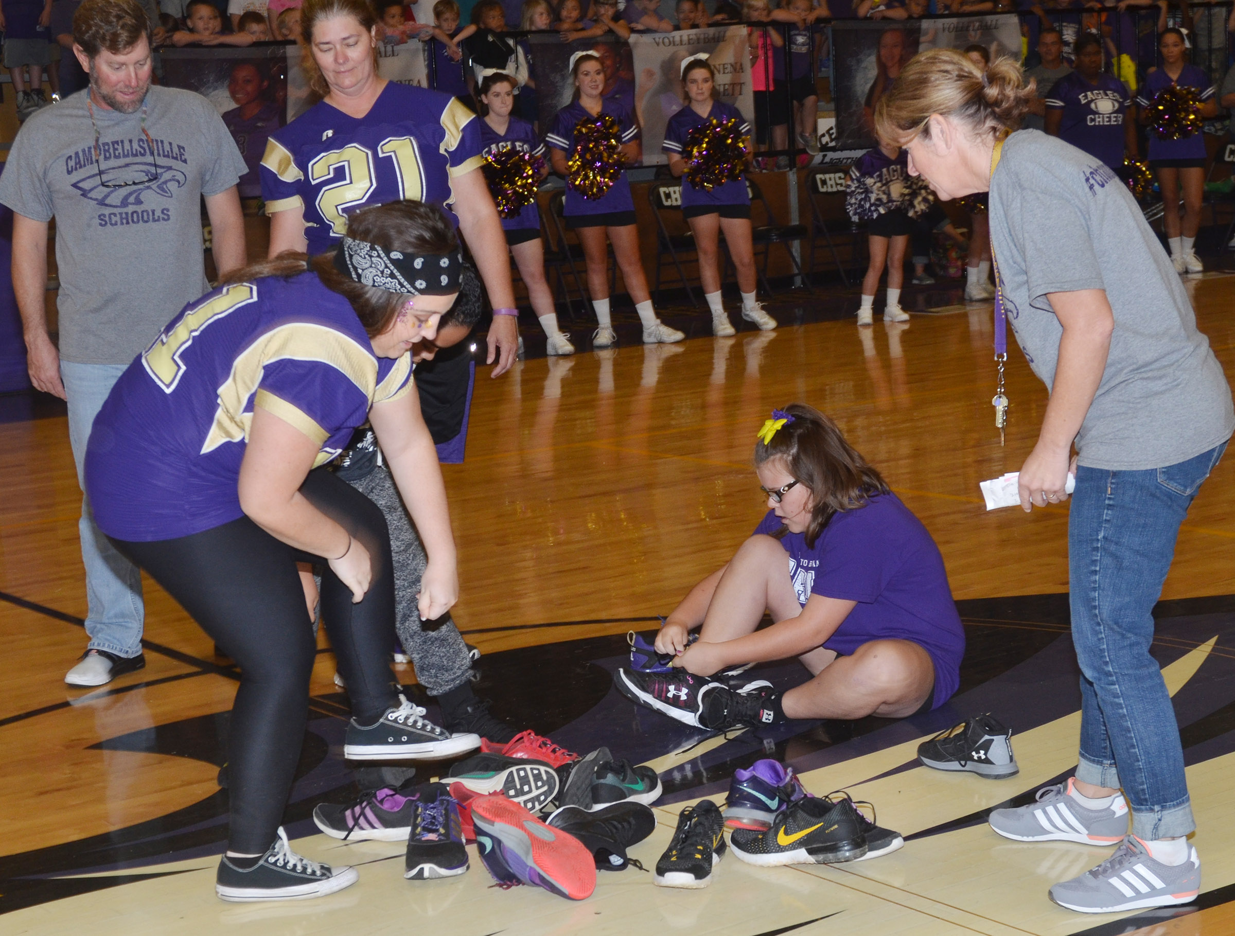 CHS senior Caitlin Bright, at left, and CES fifth-grader Keeley Dicken compete in the shoe mountain game.