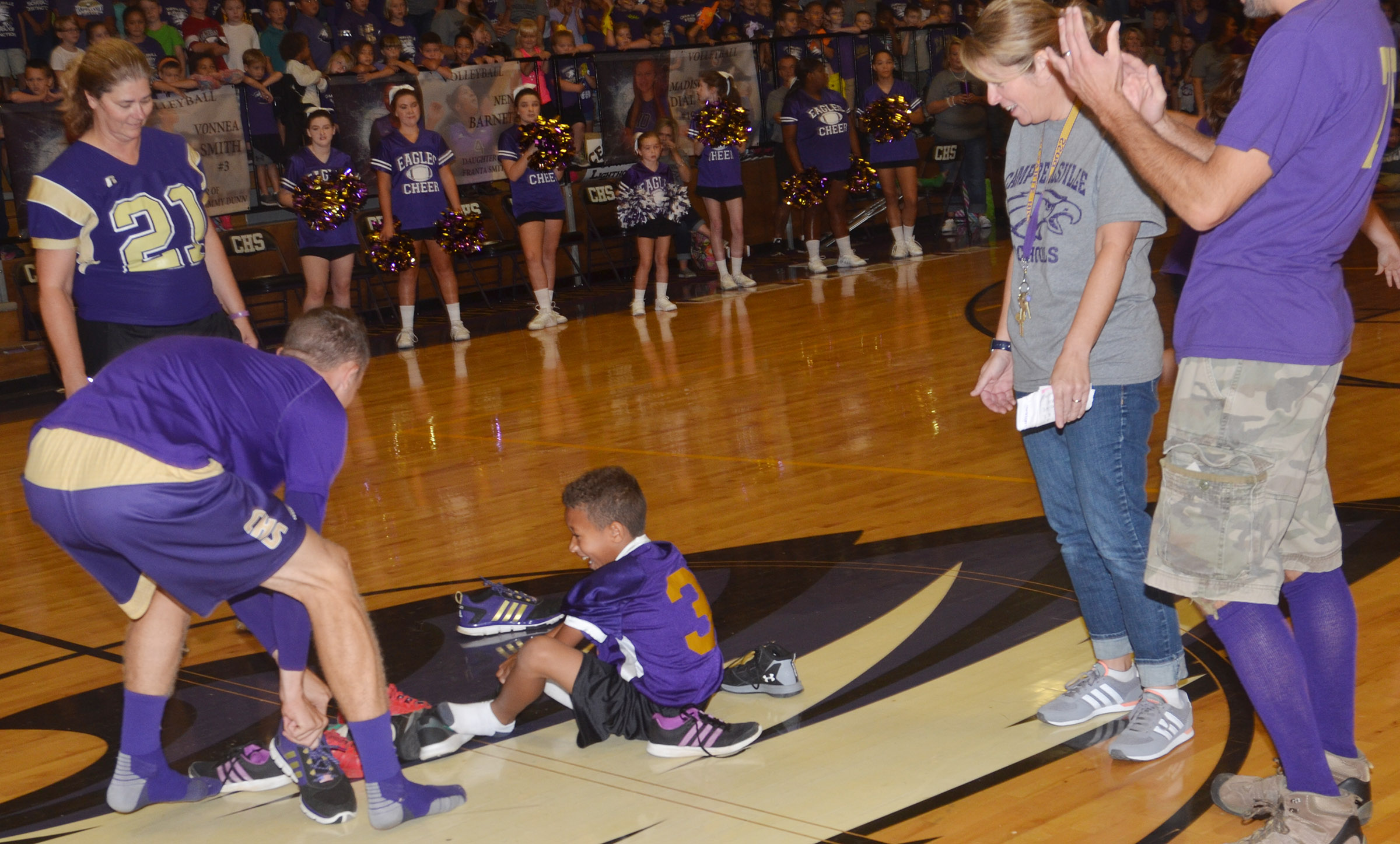 CHS senior Connor Wilson, at left, and CES third-grader Rajon Taylor compete in the shoe mountain game.