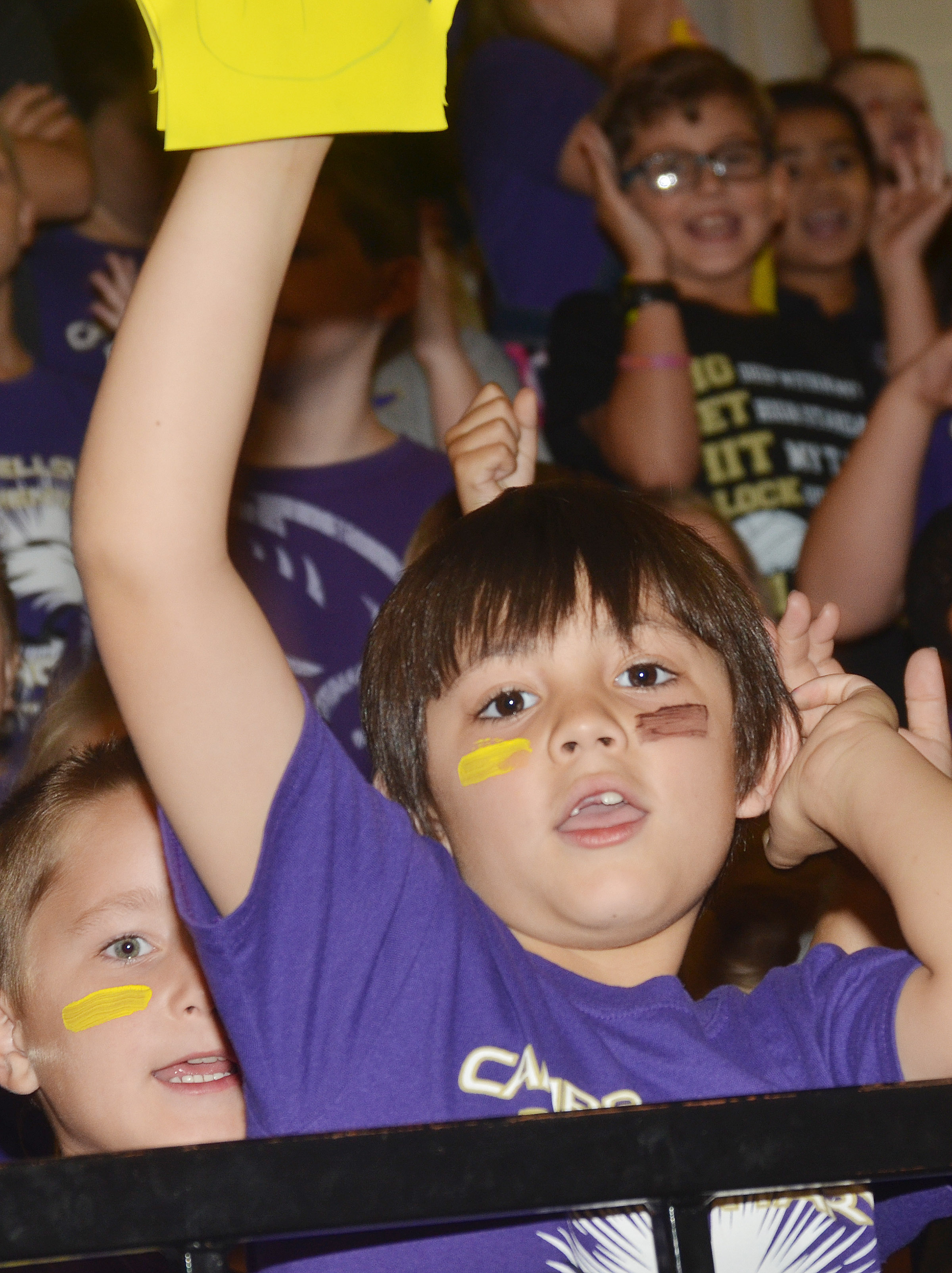 CES first-grader Keagan Shearer cheers for the Eagles.