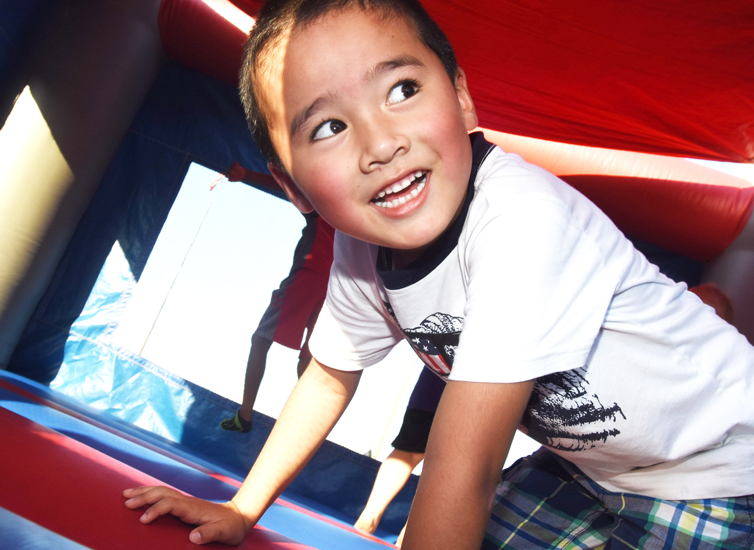 CES kindergartener Minh Turdo jumps in the bounce house.