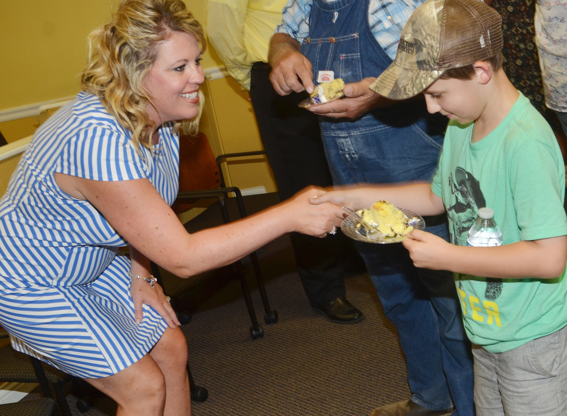 CES second-grader Aiden Forrest shakes hands with his new principal, Elisha Rhodes.