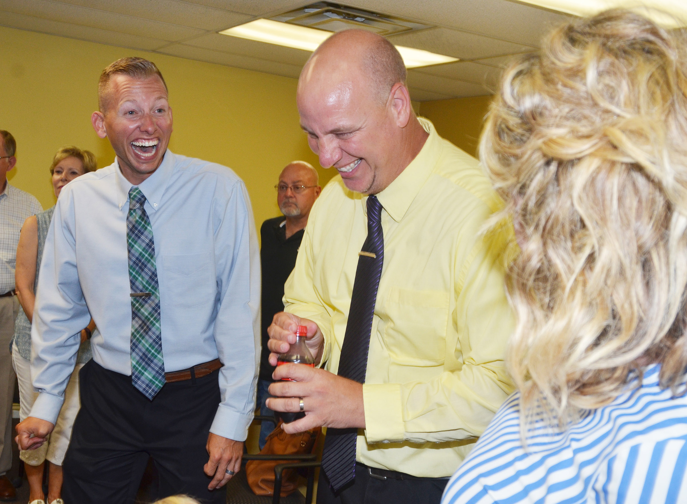 From left, CMS Principal Zach Lewis, CHS Principal David Petett and CES Principal Elisha Rhodes share a laugh.