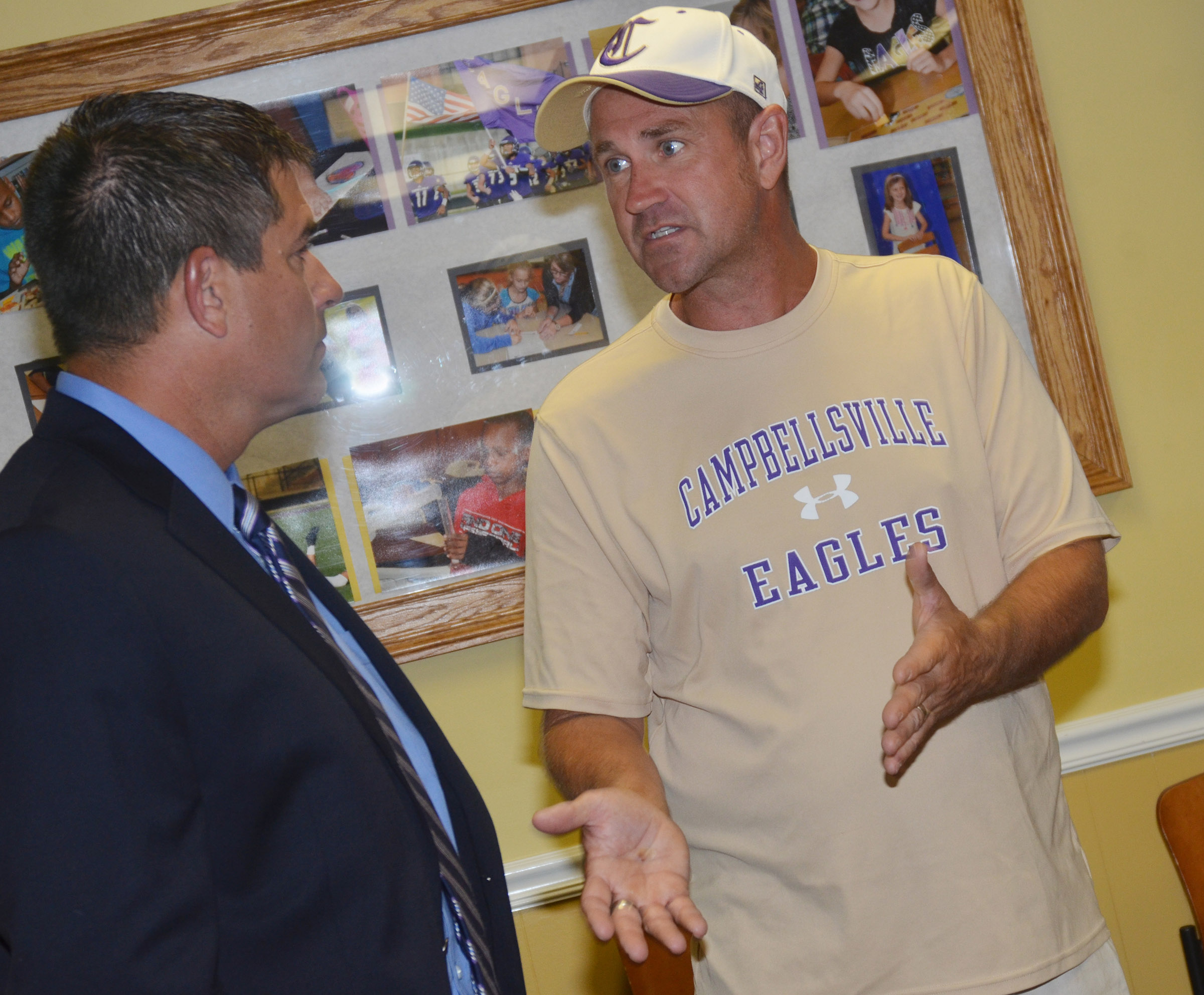 Superintendent Kirby Smith talks with CHS exceptional child educator Steve Doss.