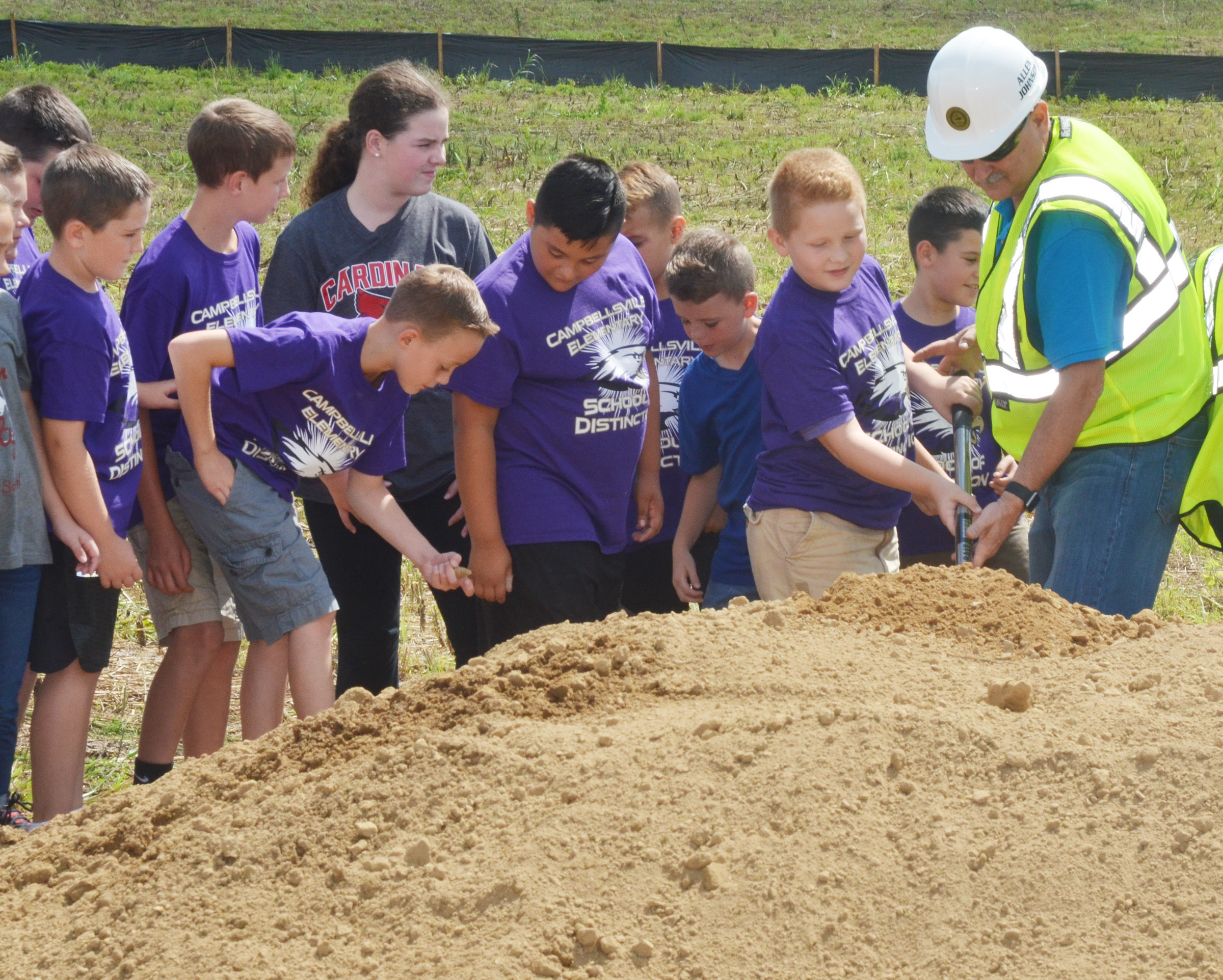 CES fourth-grader Isaiah Jeffries breaks ground for the sports complex with Campbellsville City Council member Allen Johnson.