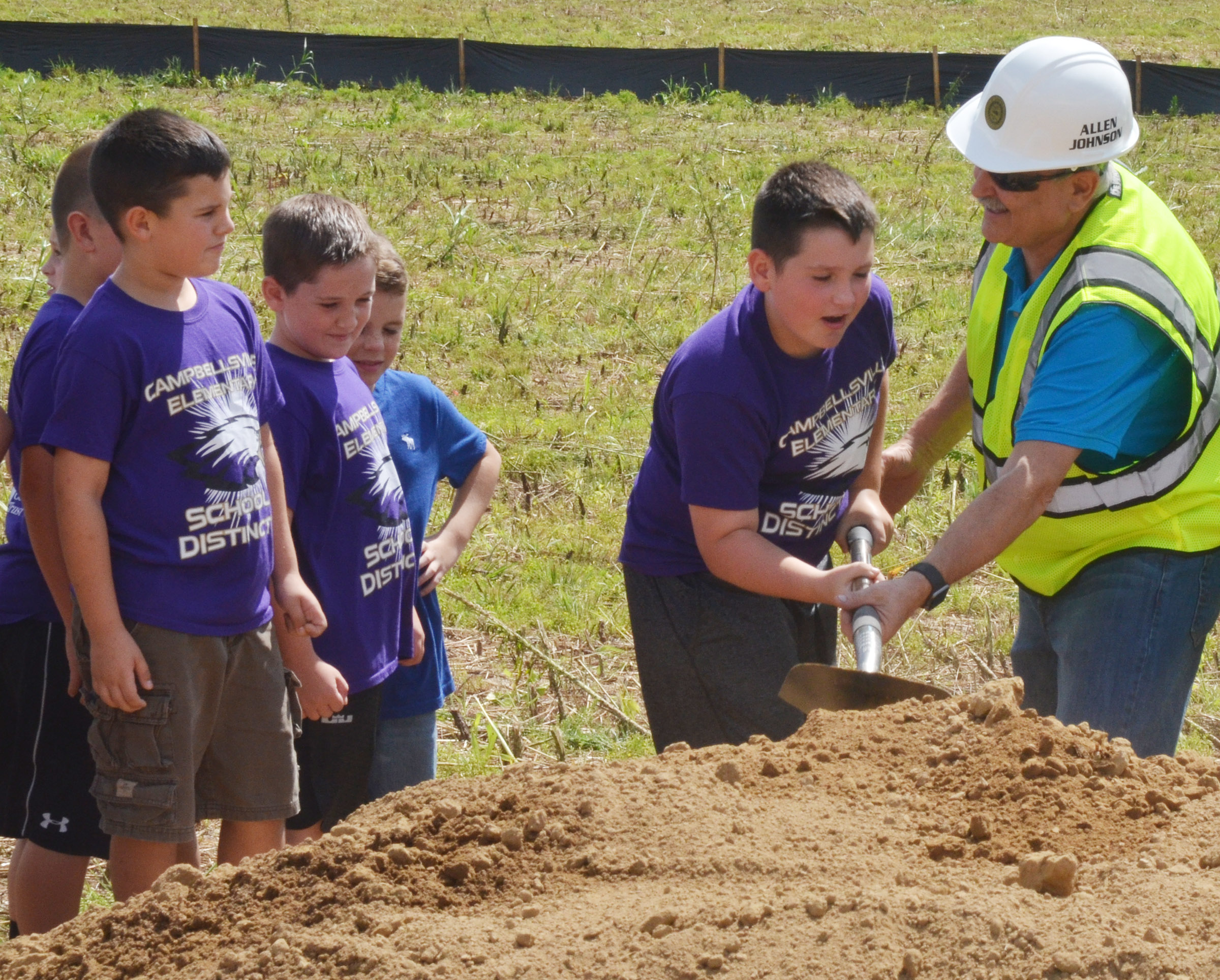 CEs fourth-grader Ethan Garrison breaks ground for the sports complex with Campbellsville City Council member Allen Johnson.