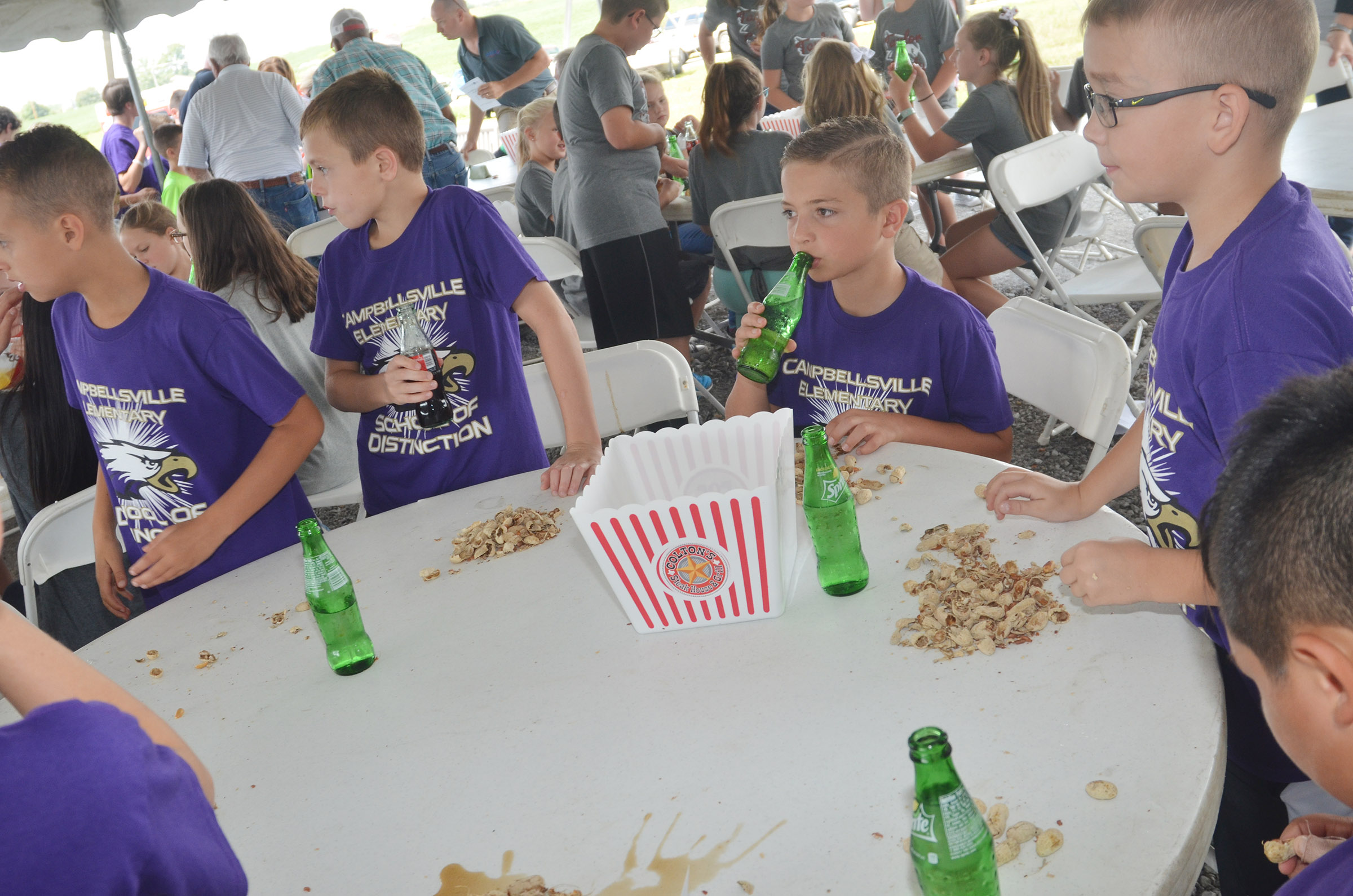 CES students, from left, fourth-graders Bradley Paris, Keaton Hord, Carson Mills and Cameron Estes enjoy peanuts and soda at the groundbreaking ceremony.