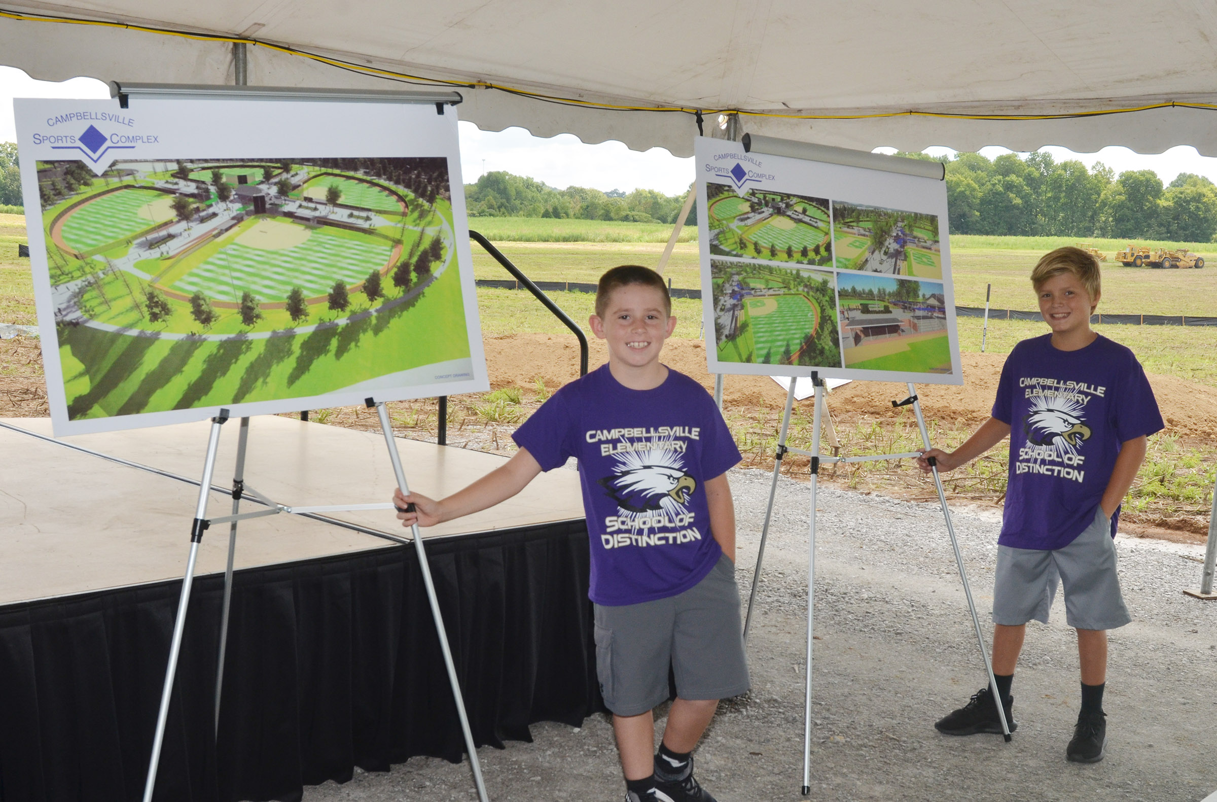 CES third-graders Lanigan Price, at left, and Emerson Gowin hold drawings of the Campbellsville Sports Complex.
