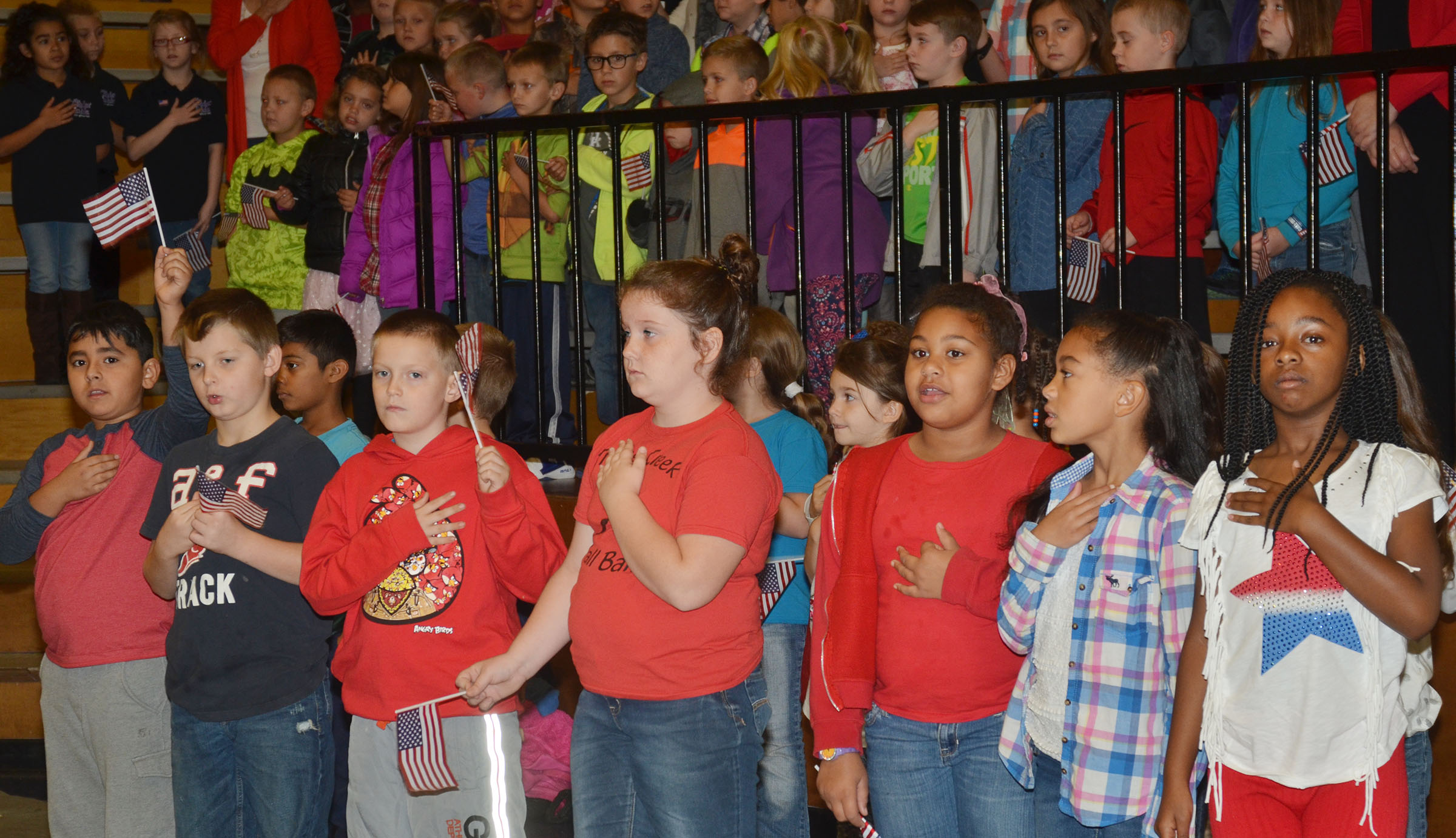 CES students place their hands on the hearts as they hear the National Anthem.
