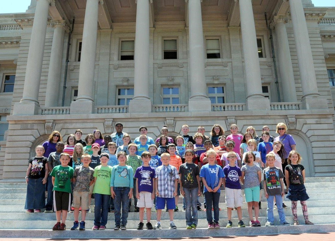 CMS fourth-graders in Garnetta Murrell's and Kaye Agathen's classes pose for a photo on the state capitol steps.