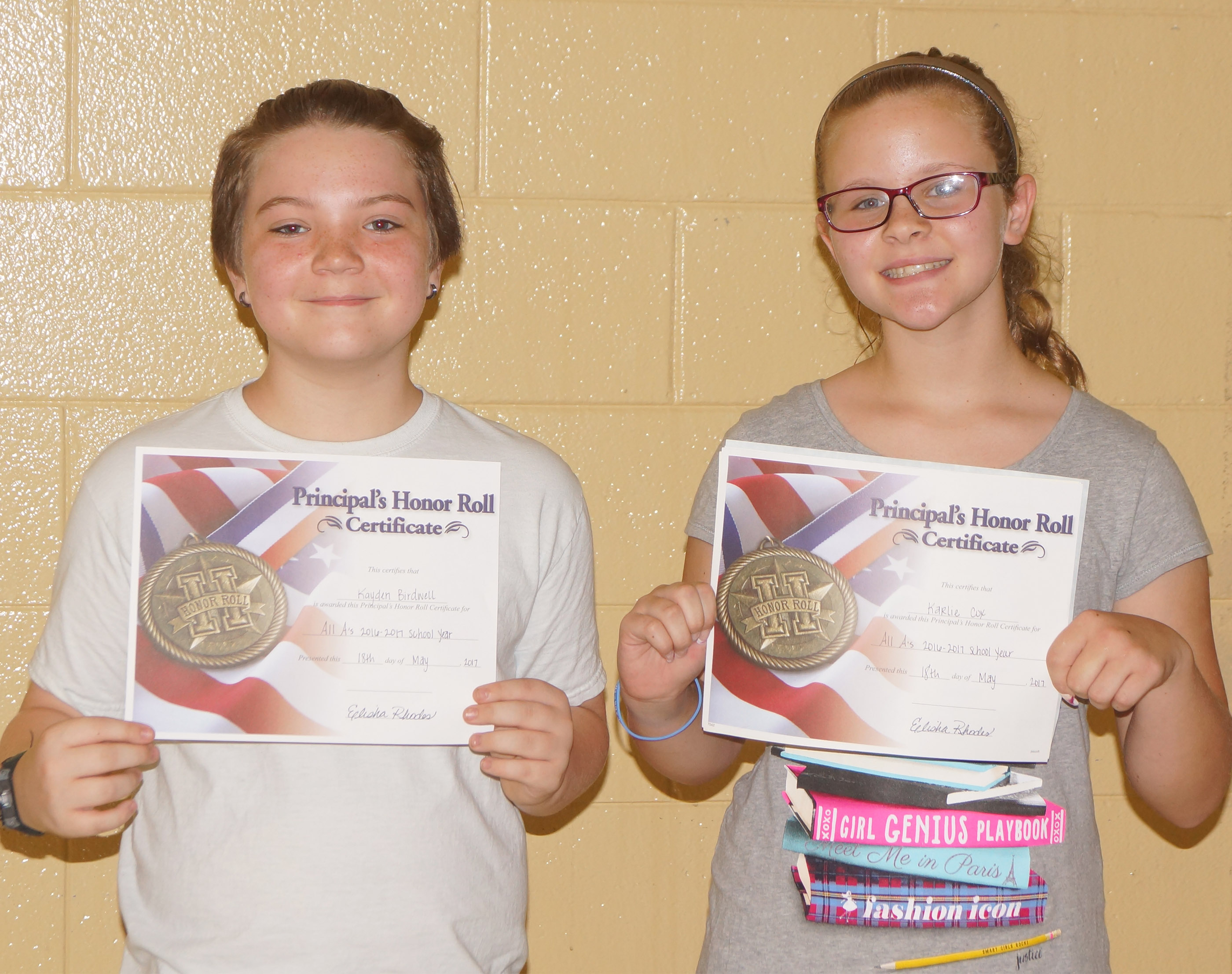 Fifth-graders receiving the principal's honor roll award are Kayden Birdwell and Karlie Cox.