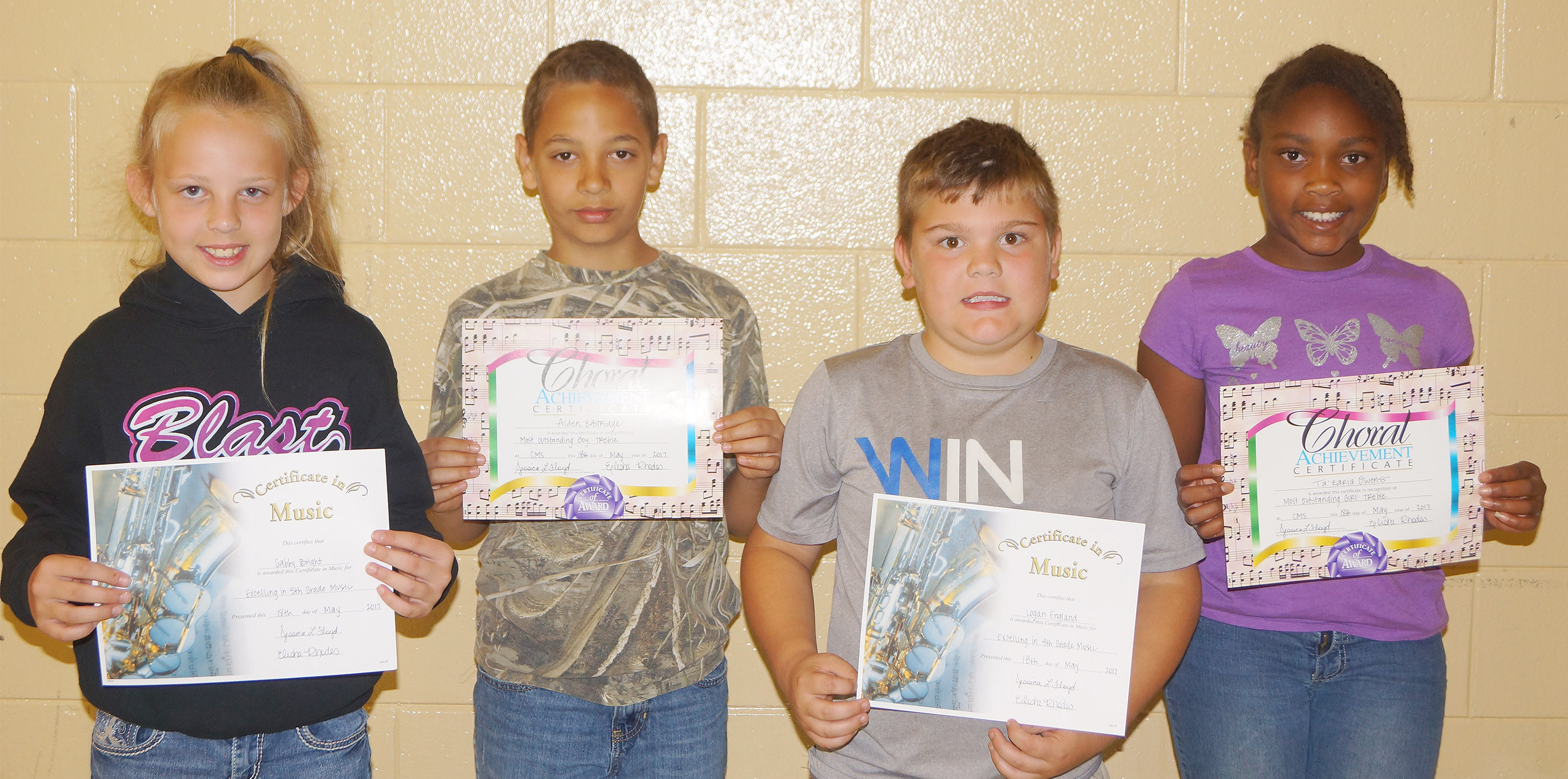 Music award winners are, from left, fifth-grader Gabby Bright, general music; fourth-grader Aiden Eastridge, most outstanding boy; fourth-grader Logan England, general music; and fourth-grader Ta'Zaria Owens, most outstanding girl.
