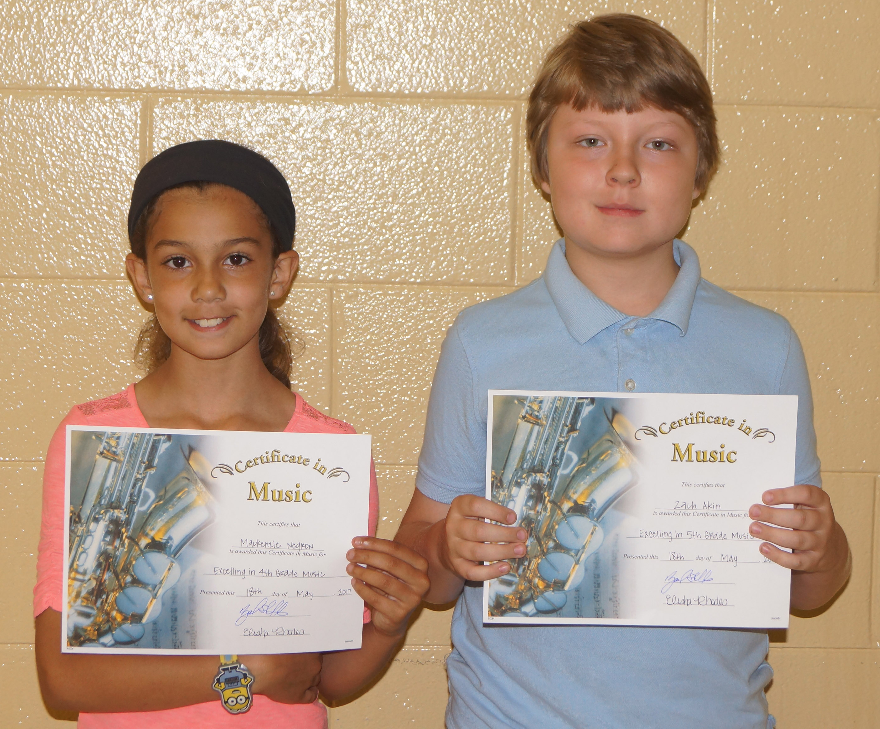 Instrumental music award winners are fourth-grader Mackenzie Negron and fifth-grader Zachary Akin.