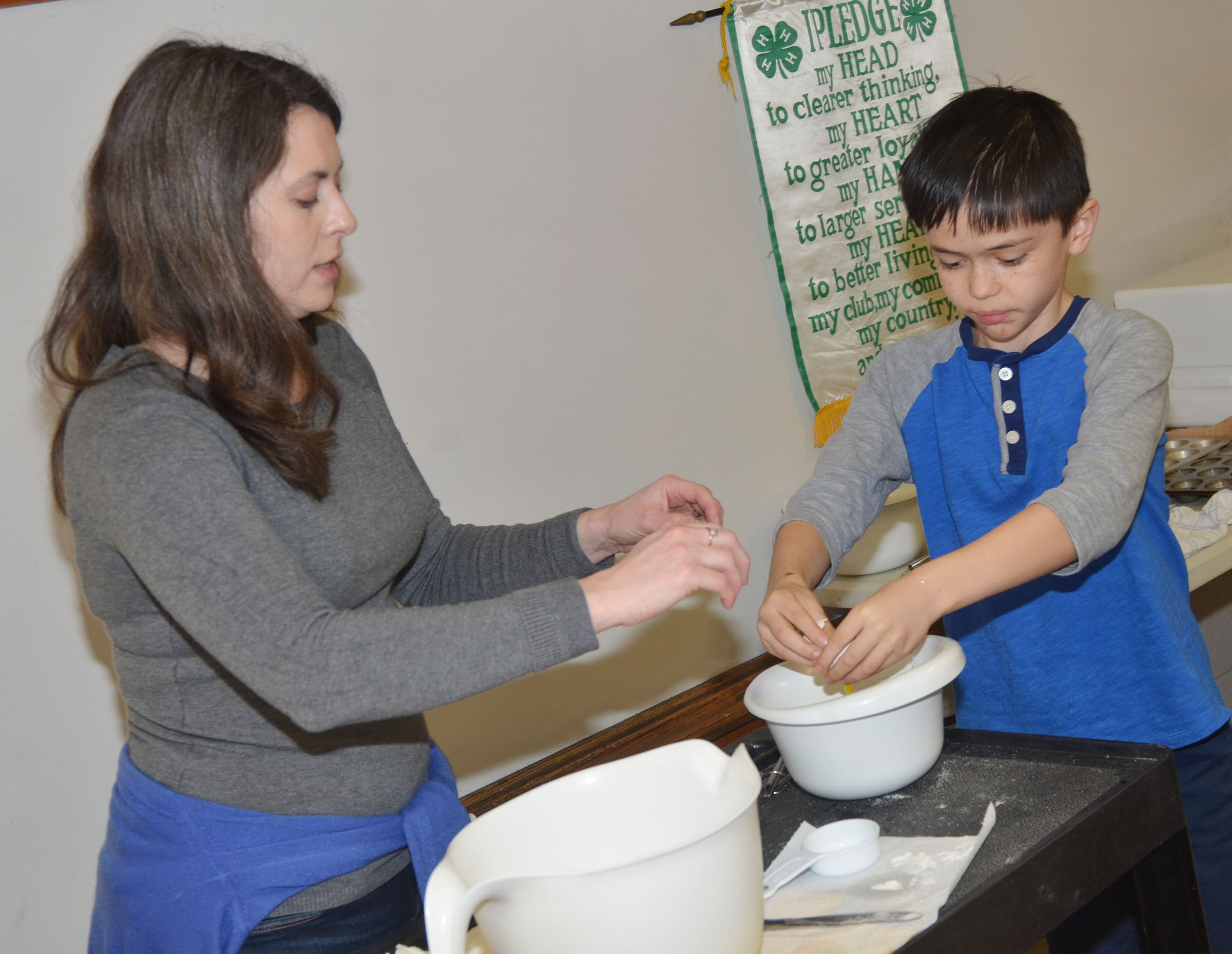 Taylor County Extension Agent for 4-H/Youth Development Amanda Sublett helps CMS fifth-grader Isacc Billeter crack an egg.