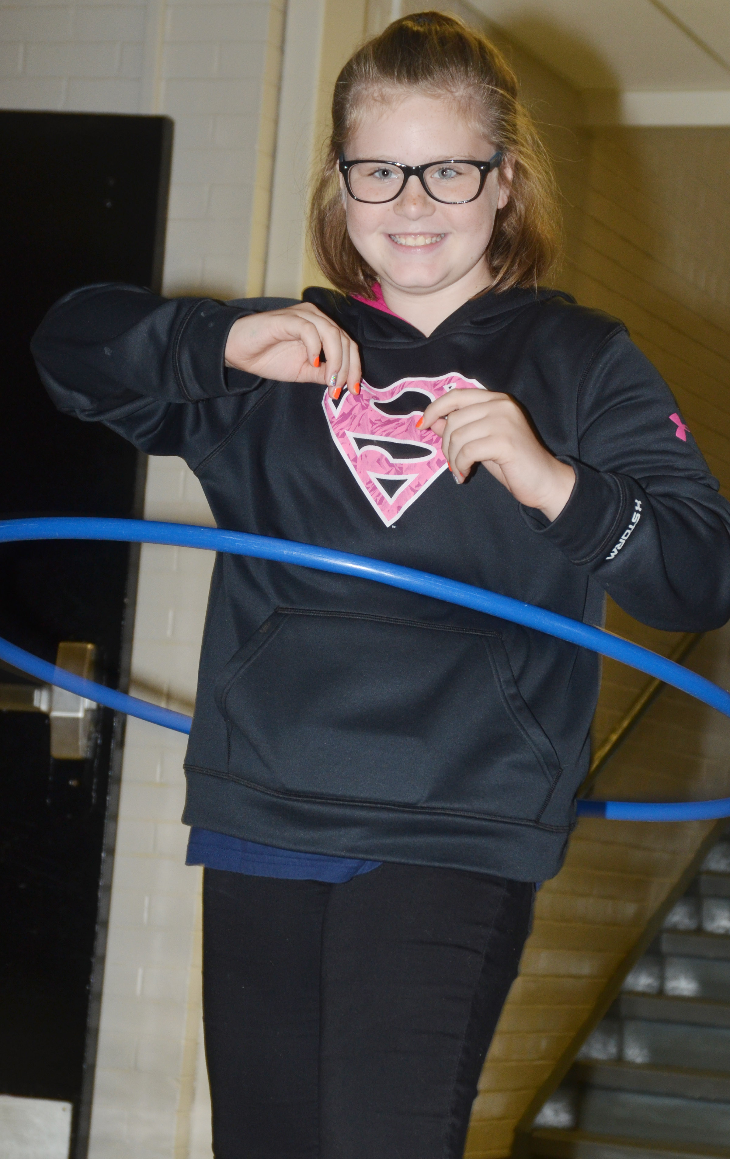 CMS sixth-grader Piper Ritchie hula hoops during her Sharpen the Saw time.