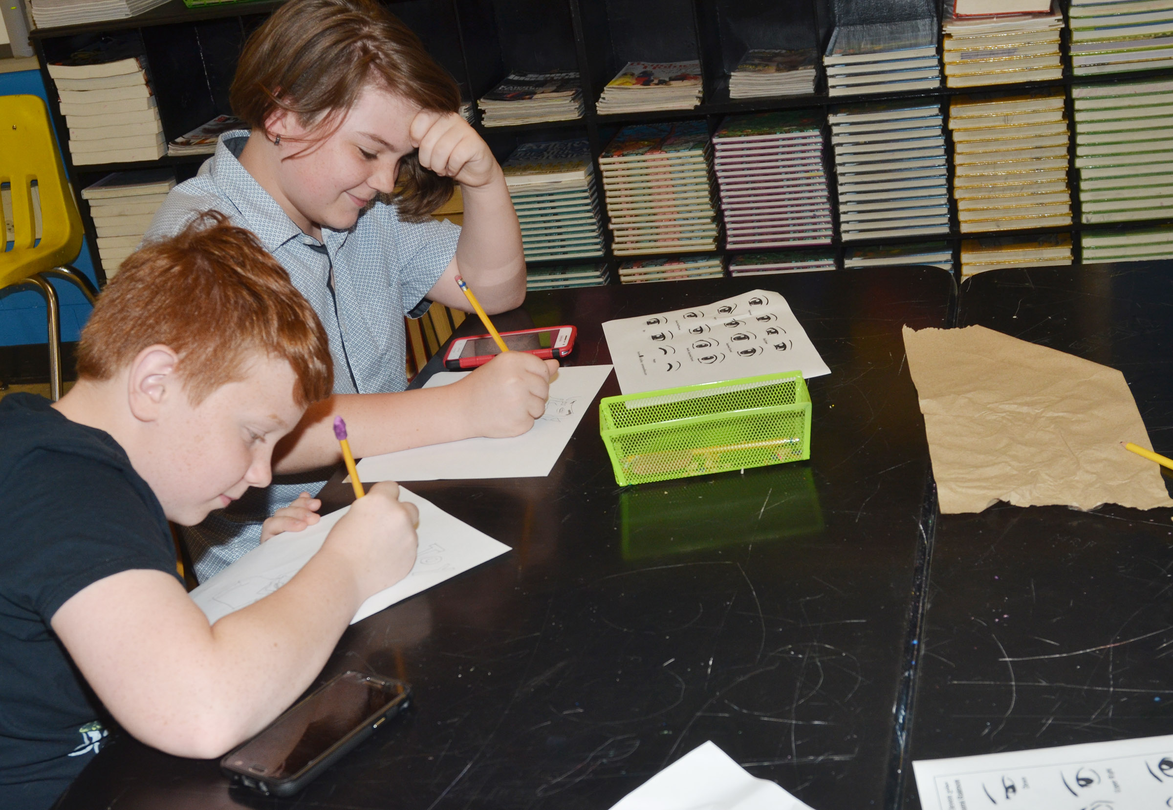 CMS sixth-graders Conner Rinehart, at left, and Kayden Birdwell draw during their Sharpen the Saw time.