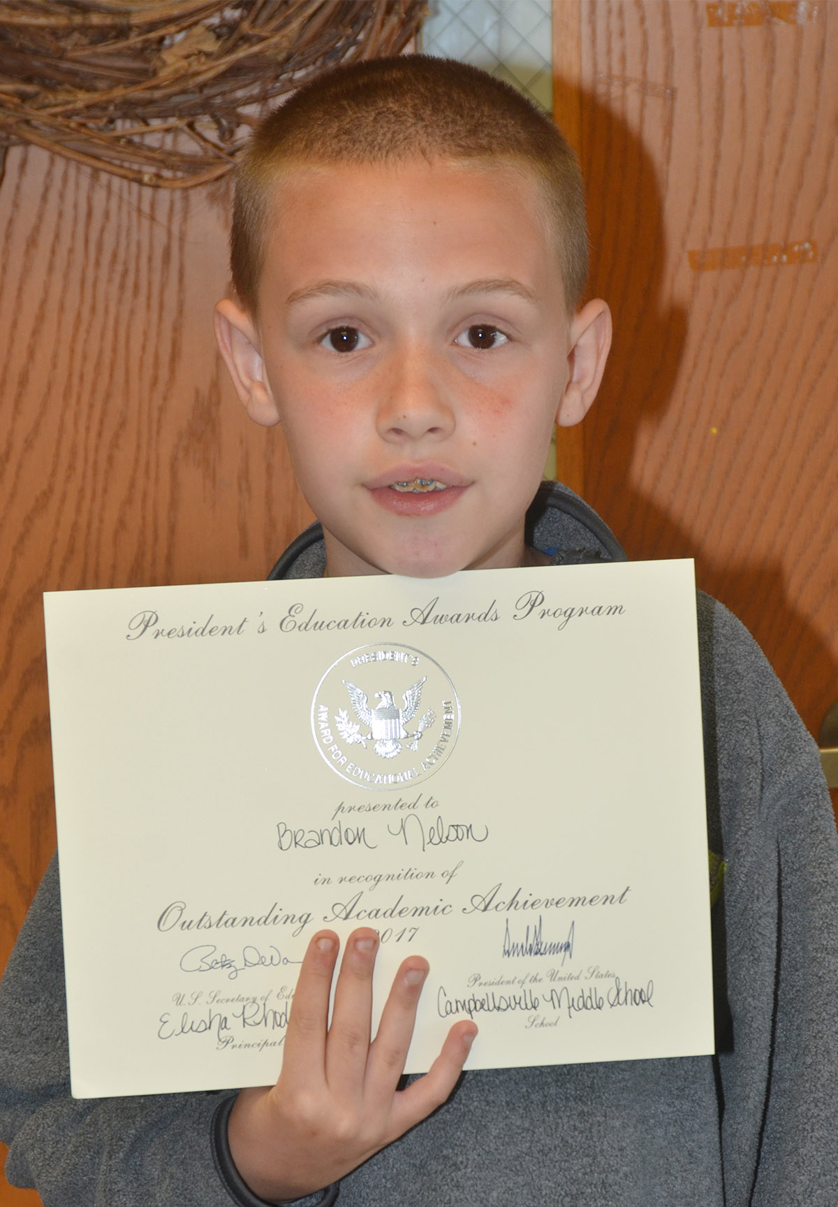 Sixth-grader Brandon Nelson received a president's award for educational achievement.