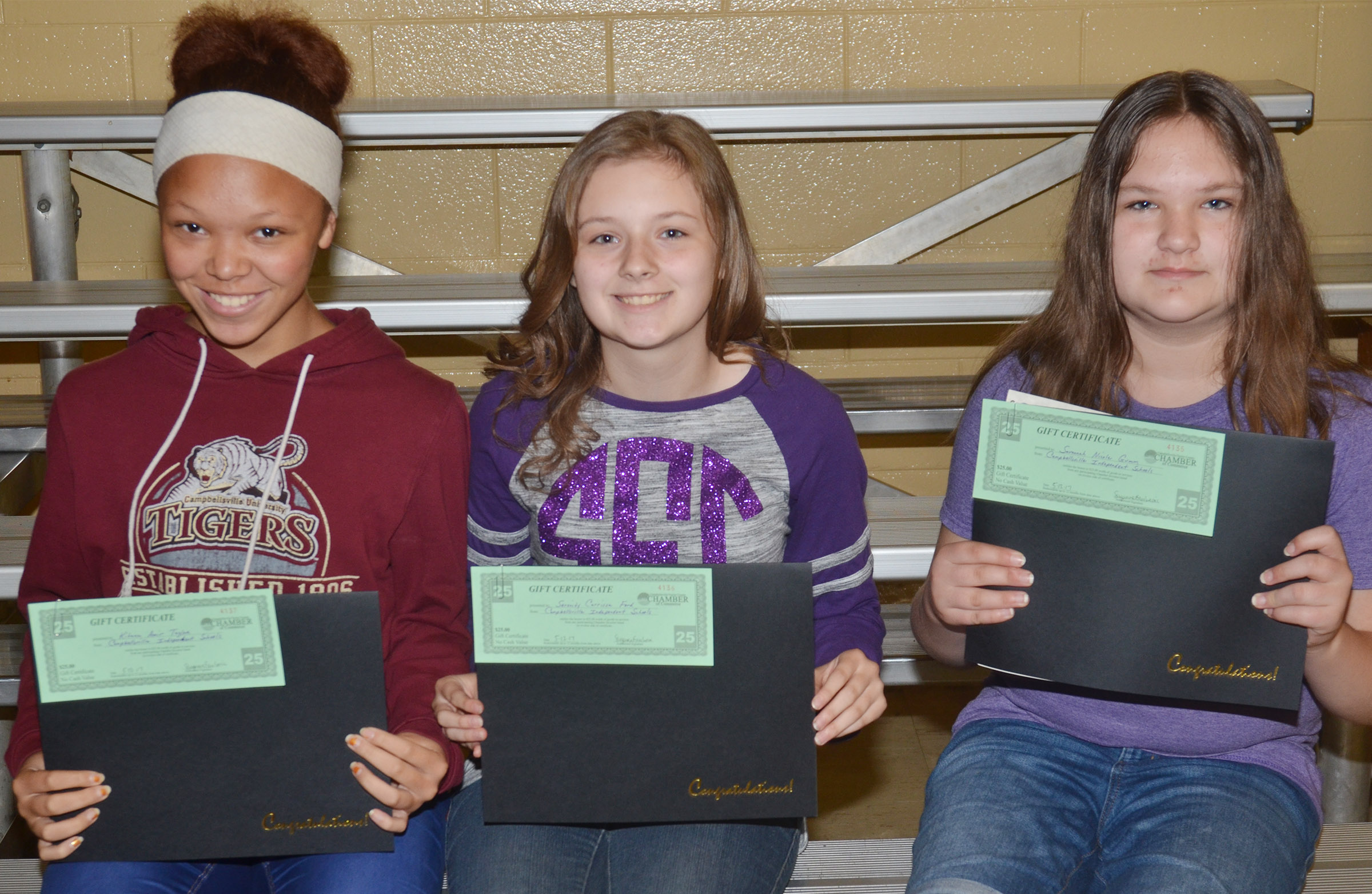 Perfect attendance awards went to seventh-graders, from left, Kitana Taylor, Serenity Ford and Savannah Gumm.