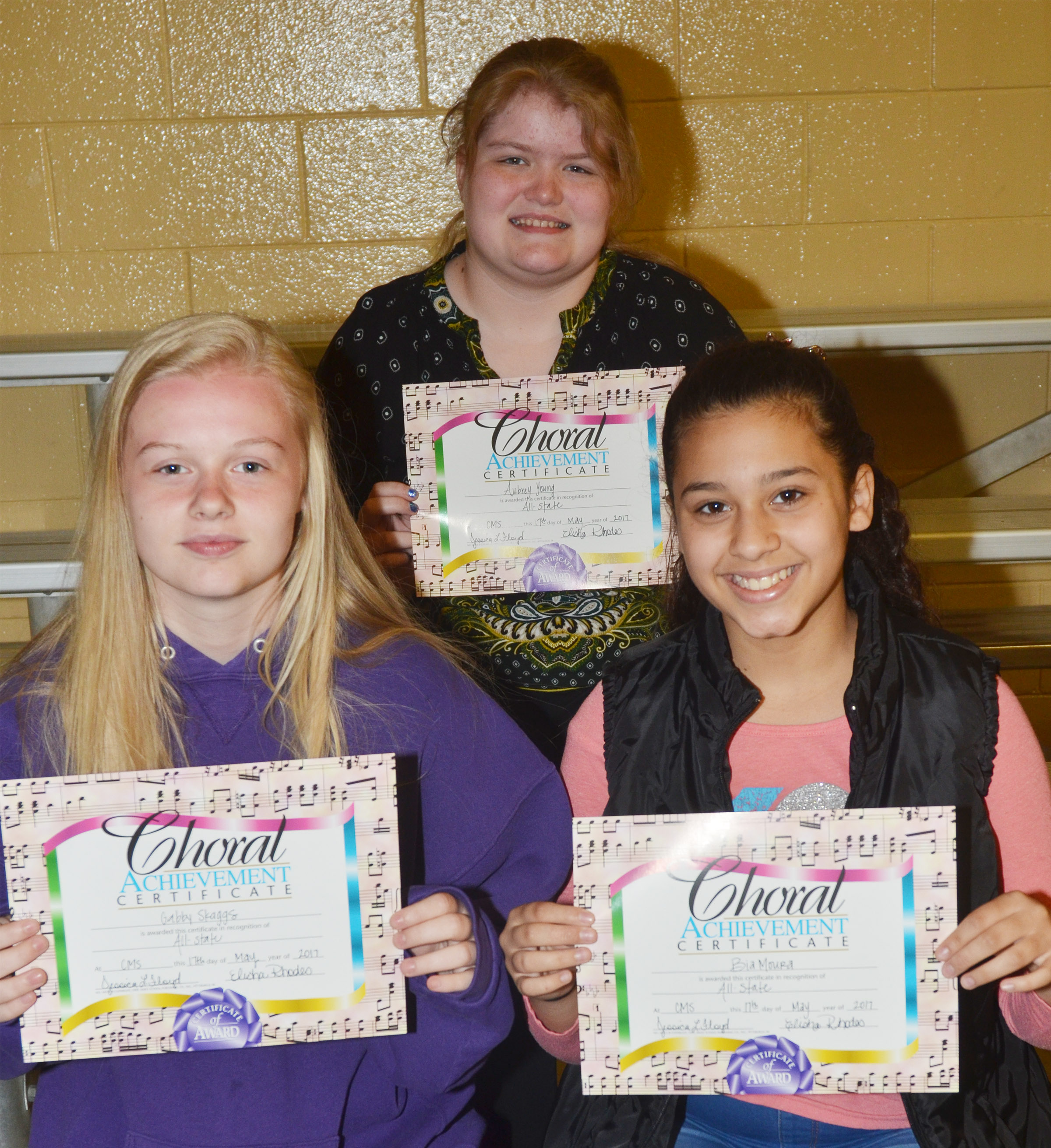 All-state chorus awards went to, from left, front, seventh-graders Gabby Skaggs and Bia Moura. Back, sixth-grader Aubrey Young.