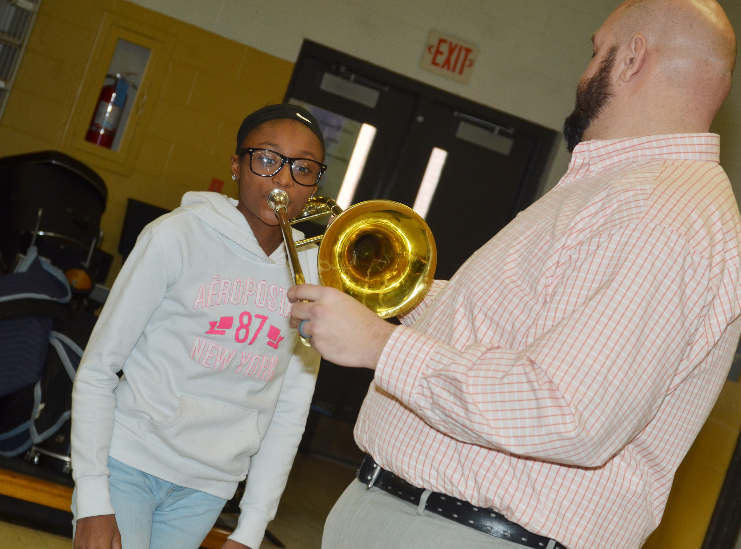 CMS seventh-grader Bri Gowdy tries to play the trombone.
