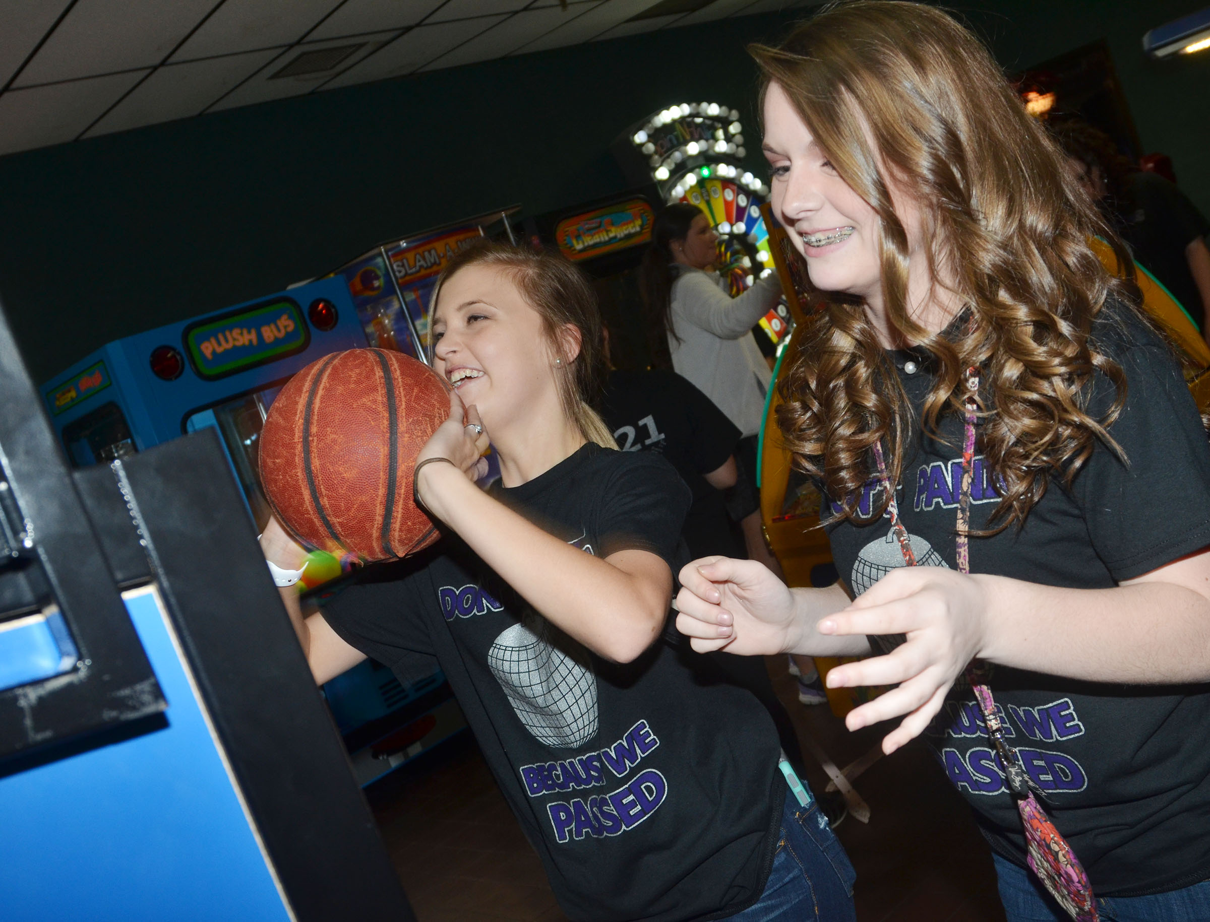 CMS eighth-graders Carly Adams, at left, and Taylor Knight play a basketball game.