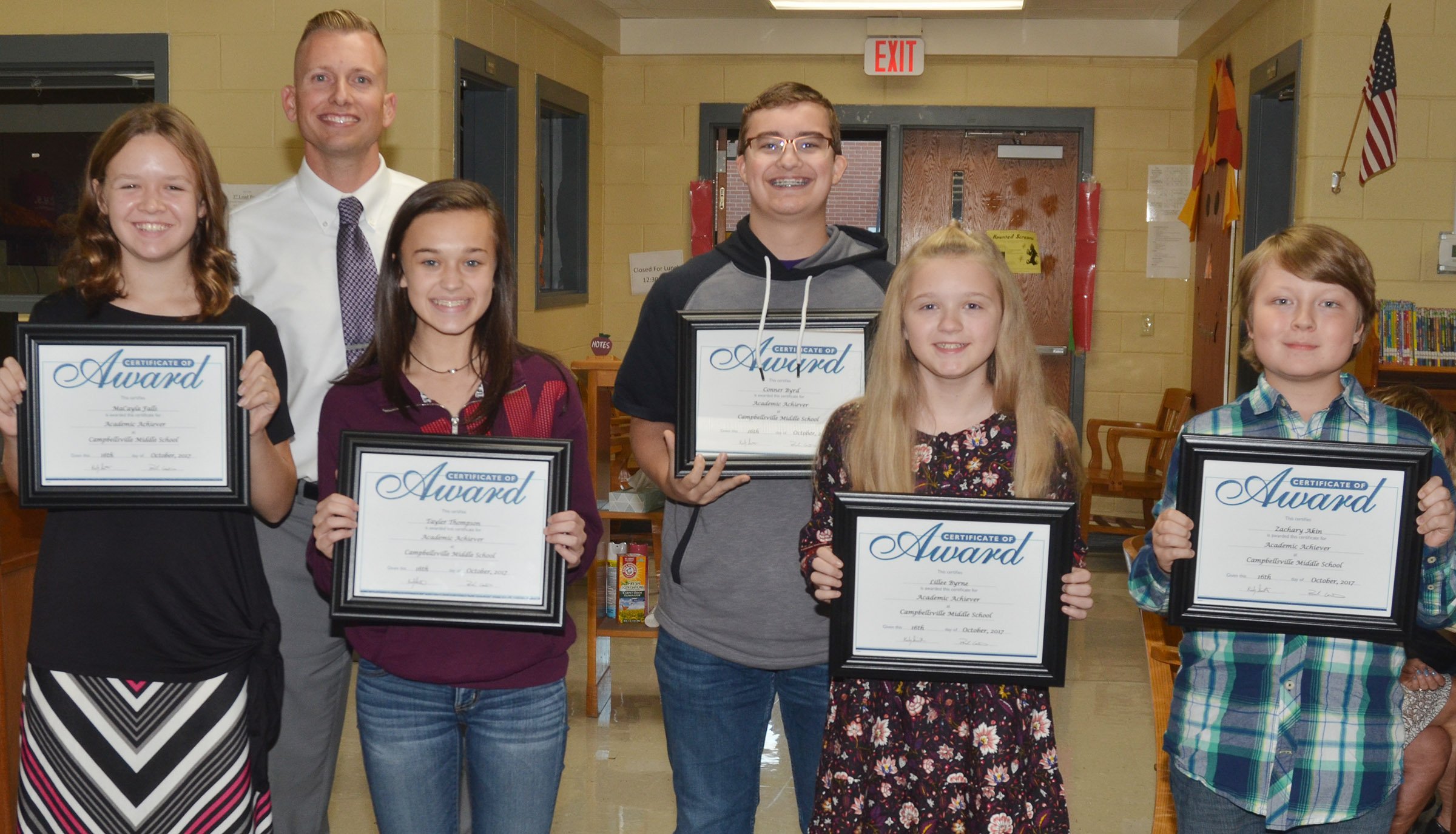 Campbellsville Middle School academic achievers for October were recognized at the Campbellsville Board of Education meeting on Monday, Oct. 16. Pictured with CMS Principal Zach Lewis, they are, from left, seventh-grader MaCayla Falls, eighth-grader Tayler Thompson, seventh-grader Connor Byrd and sixth-graders Lillee Byrne and Zachary Akin. Absent from the photo is eighth-grader Tezon Mitchell.