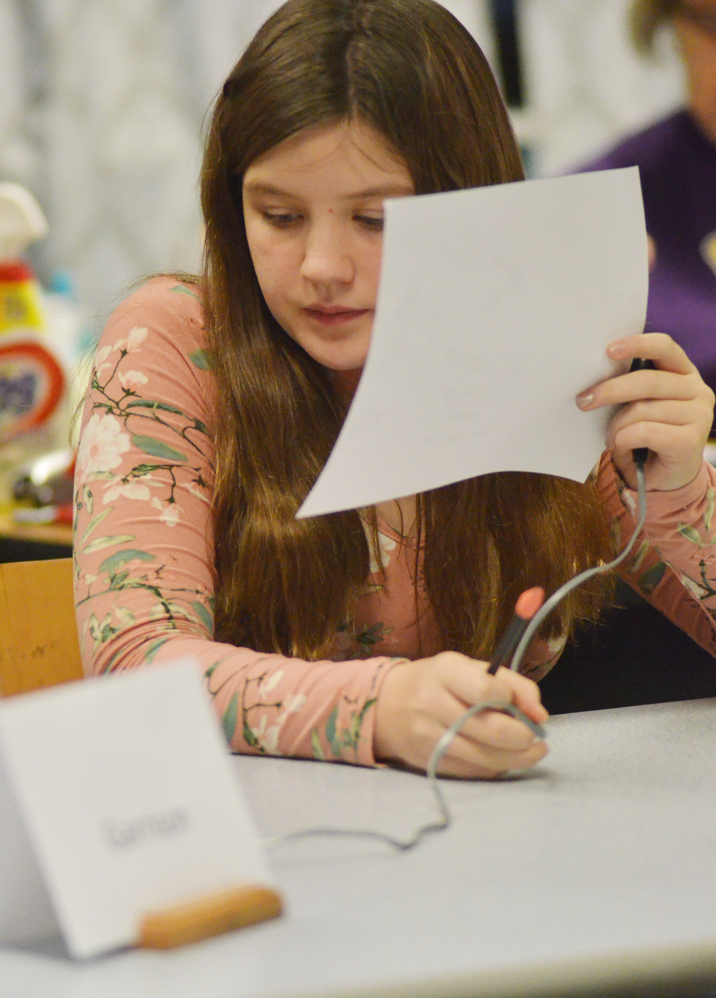 CMS seventh-grader Mikaela Scharbrough listens to a question.