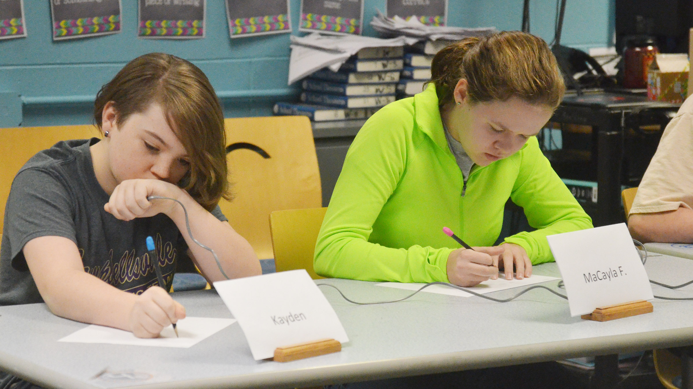 CMS sixth-graders Kayden Birdwell, at left, and MaCayla Falls work a math problem.