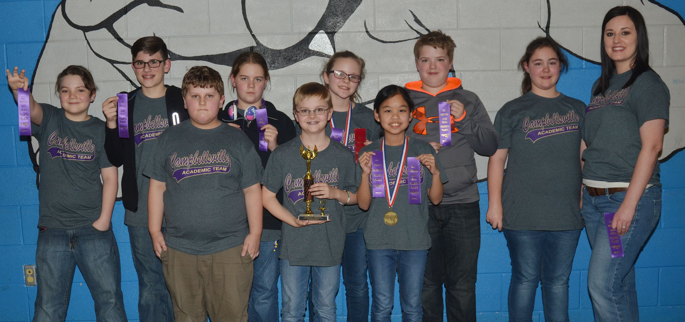 Campbellsville Middle School fourth- and fifth-grade academic team members finished in seventh place overall at region competition and fourth place in quick recall. From left, front, are fourth-grader Zeke Harris and fifth-graders Caleb Holt and Angelica Seng. Back, fifth-graders Kayden Birdwell, Isaac Garrison, Layla Steen, Karlie Cox, Ryan Grubbs and Brianna Dobson and coach Samantha Coomer. Absent from the photo are fourth-graders Logan England and Gabriel Noyola.