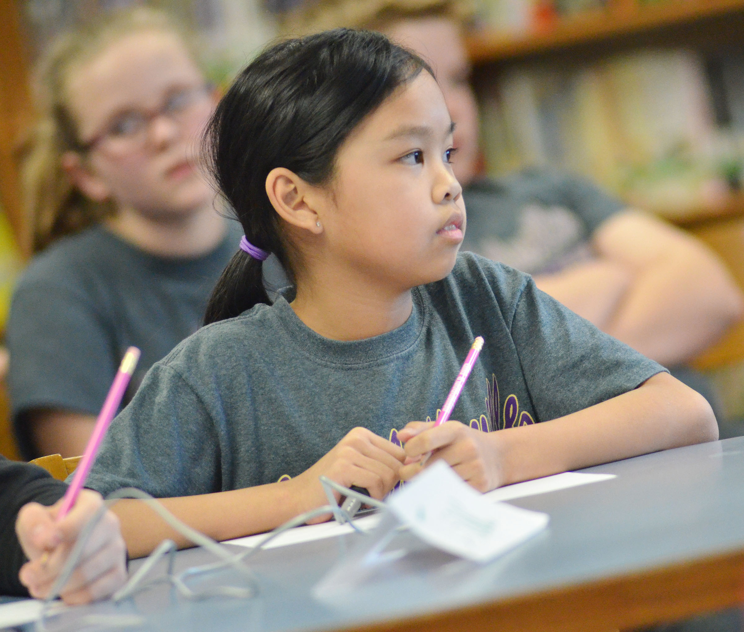 CMS fifth-grader Angelica Seng listens to a question.