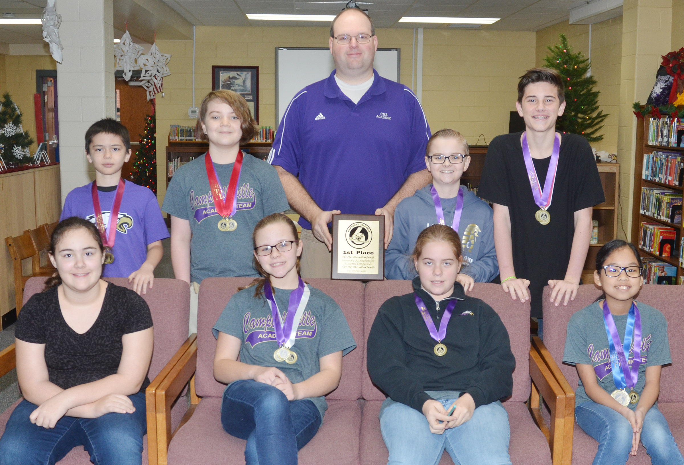 Campbellsville Middle School academic team members won the sixth-grade Showcase competition on Saturday, Dec. 2. From left, front, are academic team members Brianna Dobson, Karlie Cox, Layla Steen and Angelica Seng. Back, Isaac Billeter, Kayden Birdwell, coach Steven Gumm, Caleb Holt and Isaac Garrison.