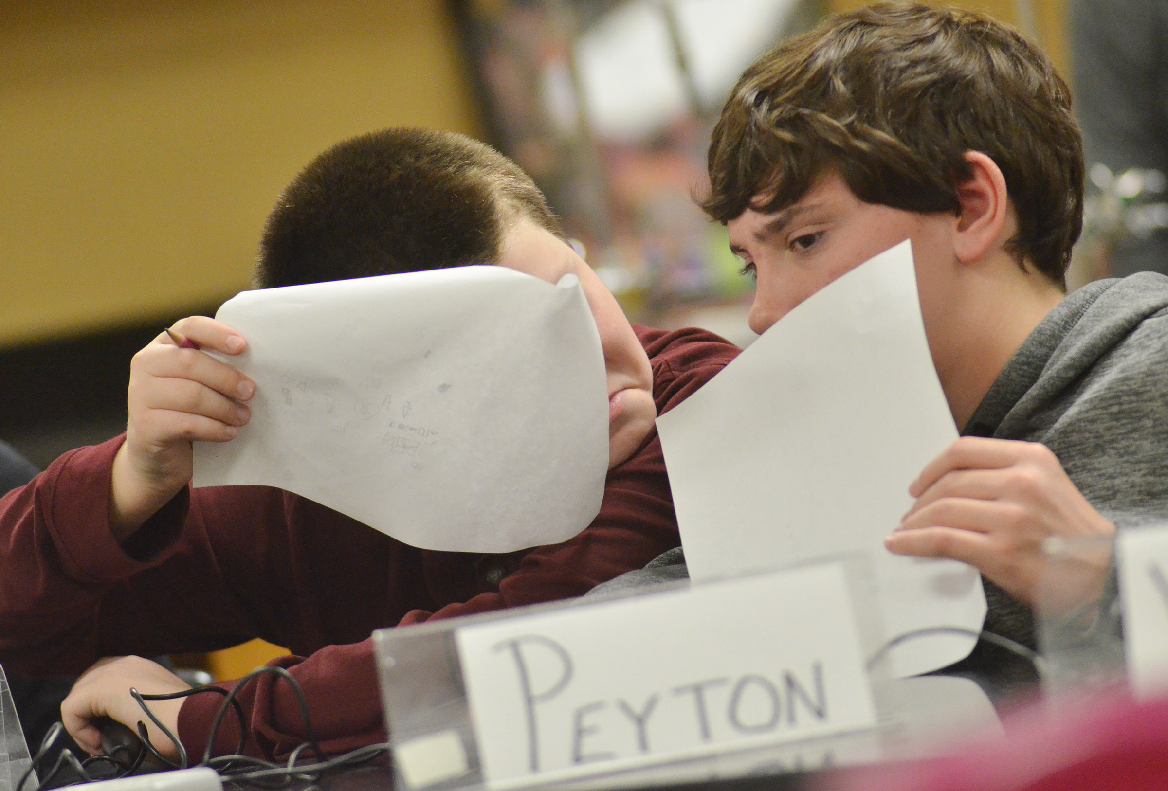 CMS seventh-graders Bailey Stearman, at left, and Peyton Dabney discuss a quick recall question.