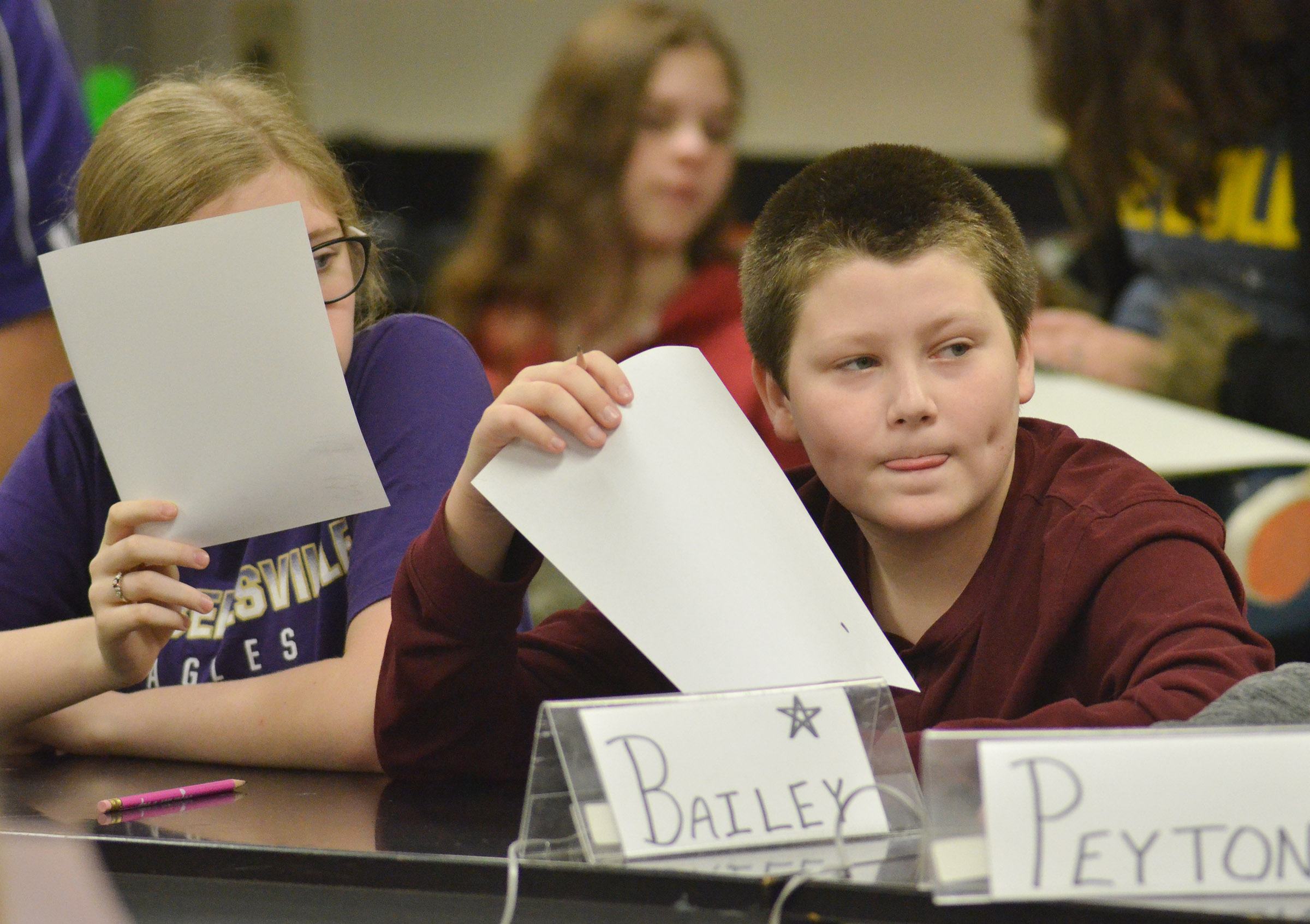 CMS sixth-grader Whitney Frashure, at left, and seventh-grader Bailey Stearman listen to a quick recall question.