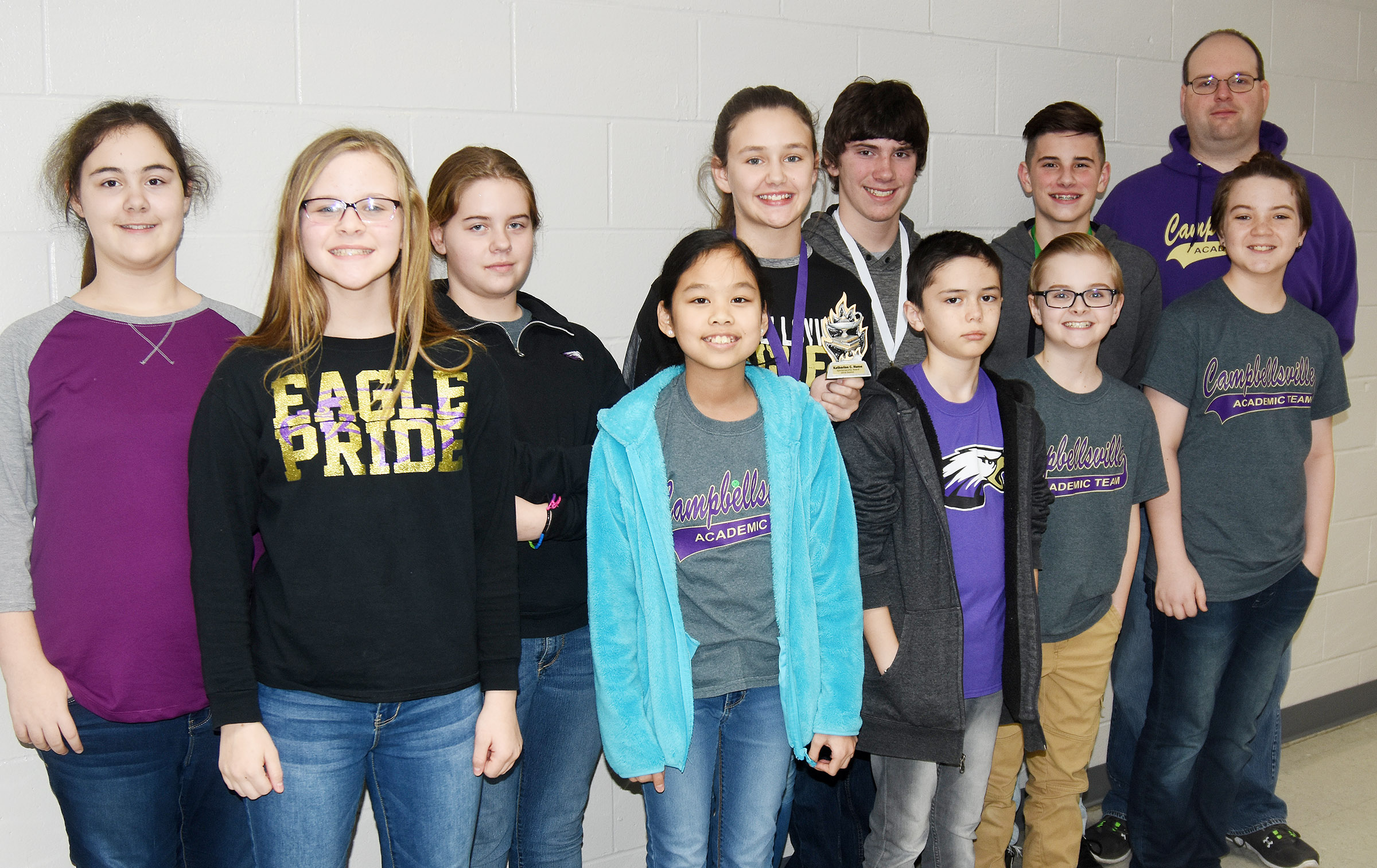 CMS academic team members competed at District Governor's Cup competition on Saturday, Jan. 20, and Monday, Jan. 22, and won several awards. And, as a result, seven students will advance to regional competition. Pictured are, from left, front, sixth-graders Karlie Cox, Angelica Seng, Isaac Billeter, Caleb Holt and Kayden Birdwell. Back, sixth-graders Brianna Dobson and Layla Steen, seventh-grader Haylee Allen, eighth-grader Peyton Dabney, sixth-grader Isaac Garrison and coach Steven Gumm. Absent from the photo is seventh-grader Whitney Frashure.