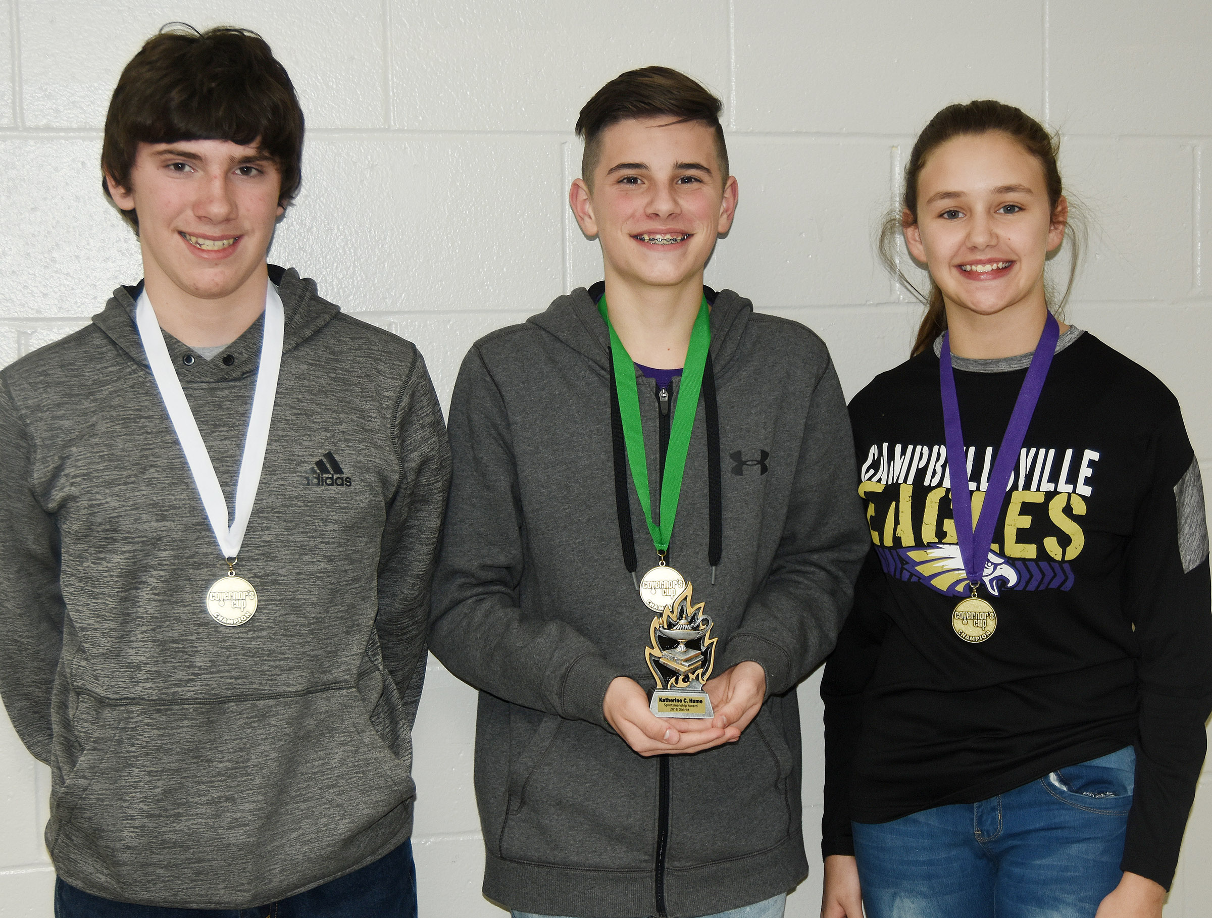 CMS academic team members won several awards at District Governor's Cup competition. Eighth-grader Peyton Dabney, at left, won third place on the social studies exam. Sixth-grader Isaac Garrison, center, and seventh-grader Haylee Allen tied for fourth place on the math written exam. MaCayla Falls, a seventh-grader, not pictured, won third place on the science exam. In written composition, Allen received third place and sixth-grader Karlie Cox, not pictured, won fifth place.