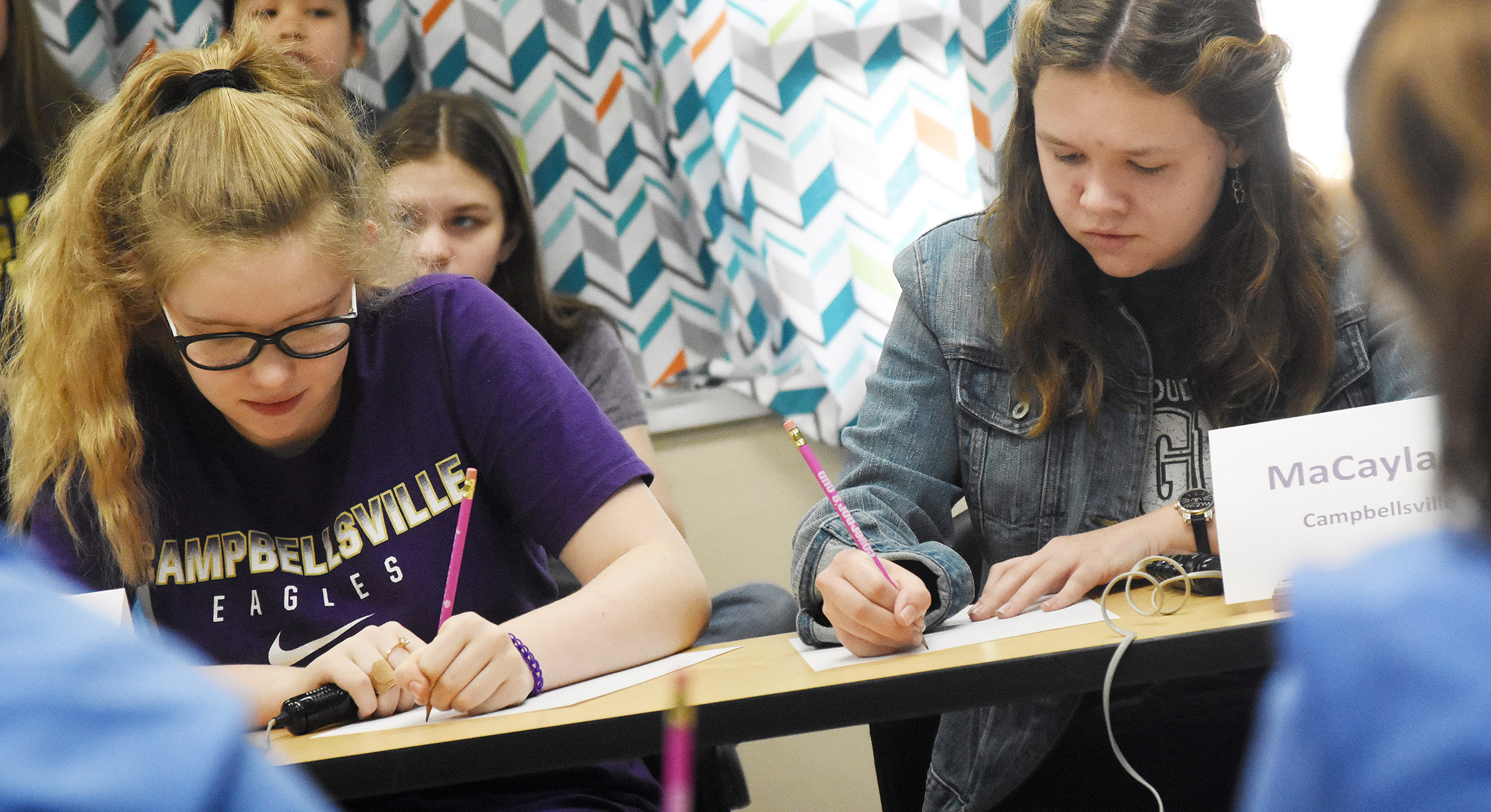 CMS seventh-graders Whitney Frashure, at left and MaCayla Falls work a math problem during a quick recall match.