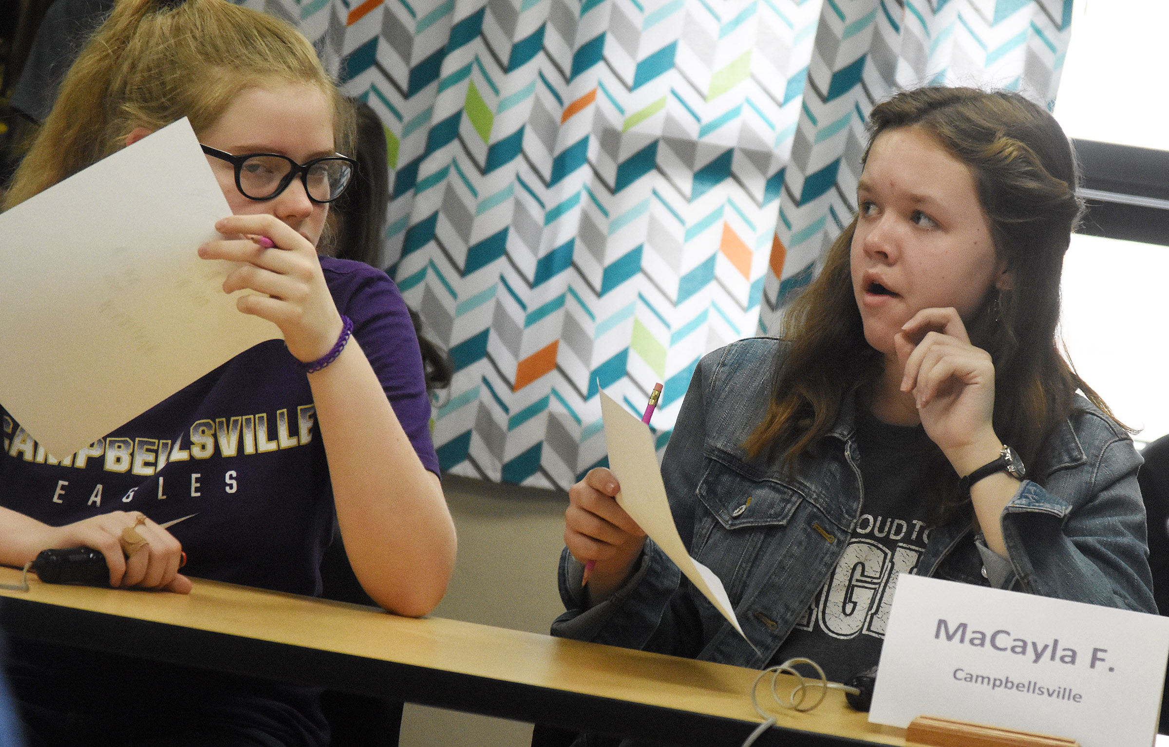 CMS seventh-graders Whitney Frashure, at left, and MaCayla Falls listen to a question during a quick recall match.